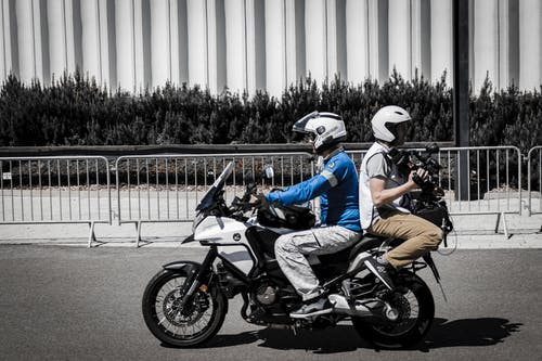 Two Men Riding Motorcycle