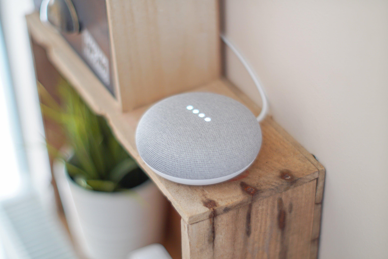Round Grey Speaker On Brown Board