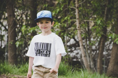 Boy In White Shirt And Blue Fitted Cap