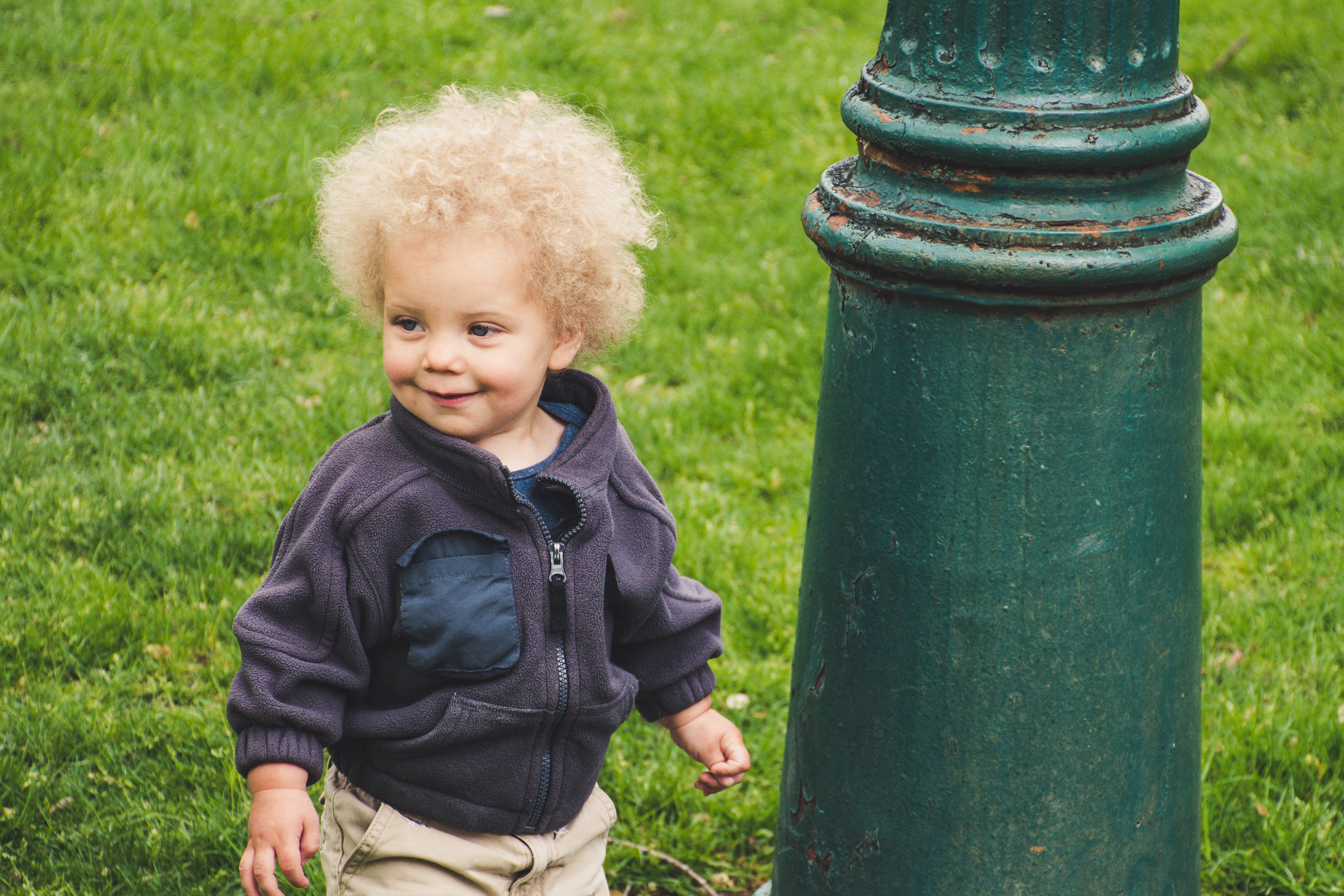 Toddler Wearing Jacket Beside the Light Post