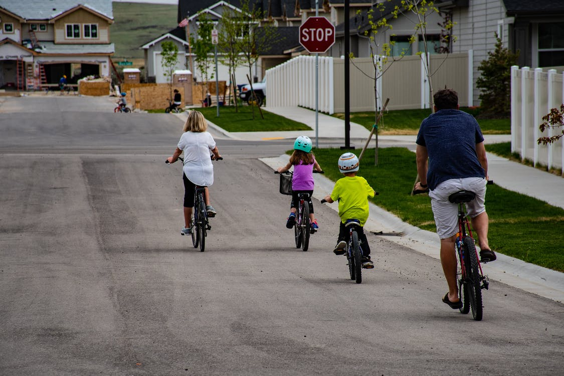Family of 4 Riding on Bicycles