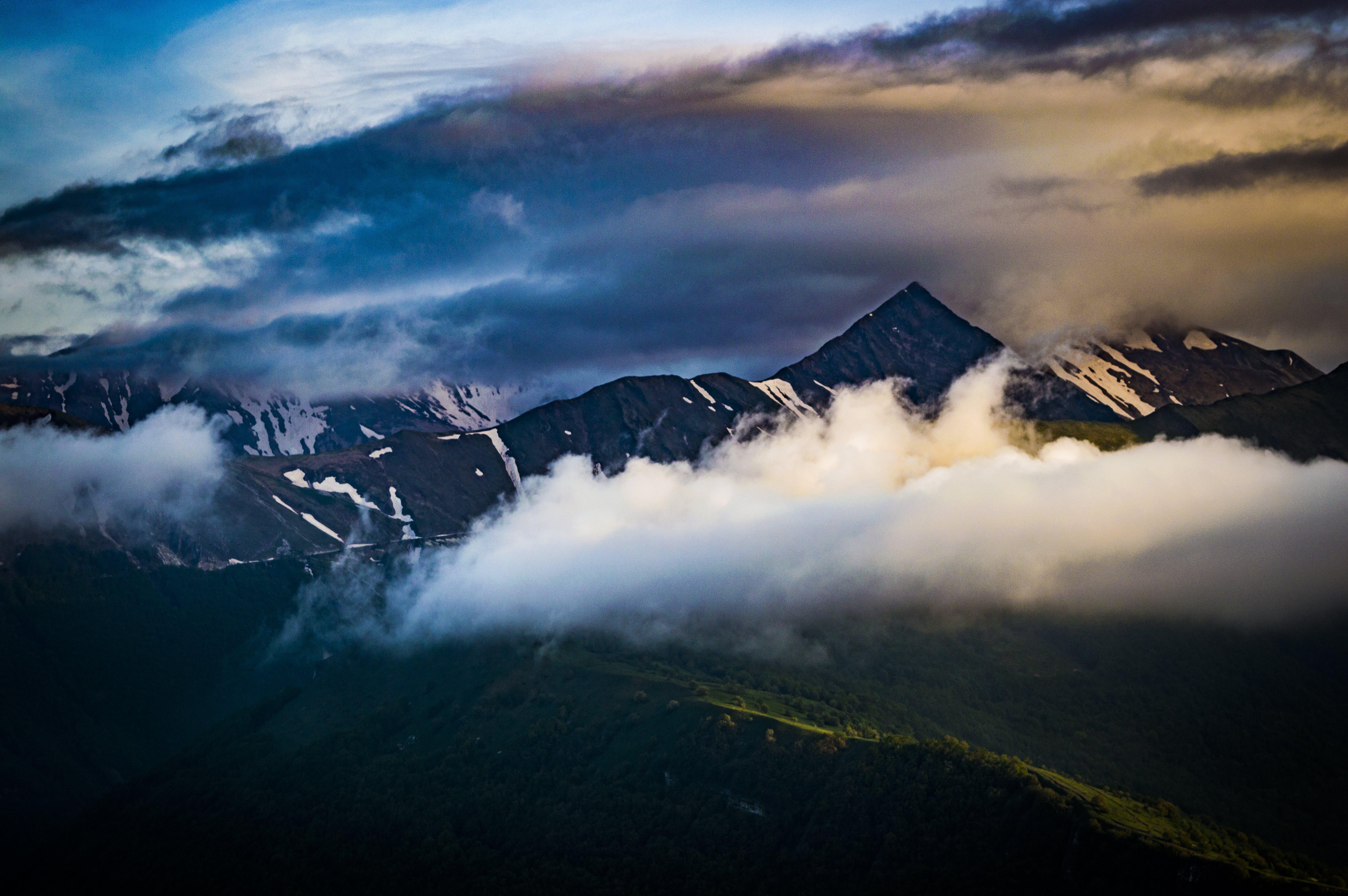 Cumulus Clouds Over Mountain Peak