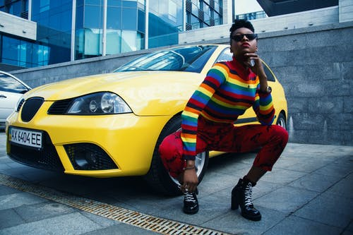 Woman Wearing Red Leggings Beside Yellow Car