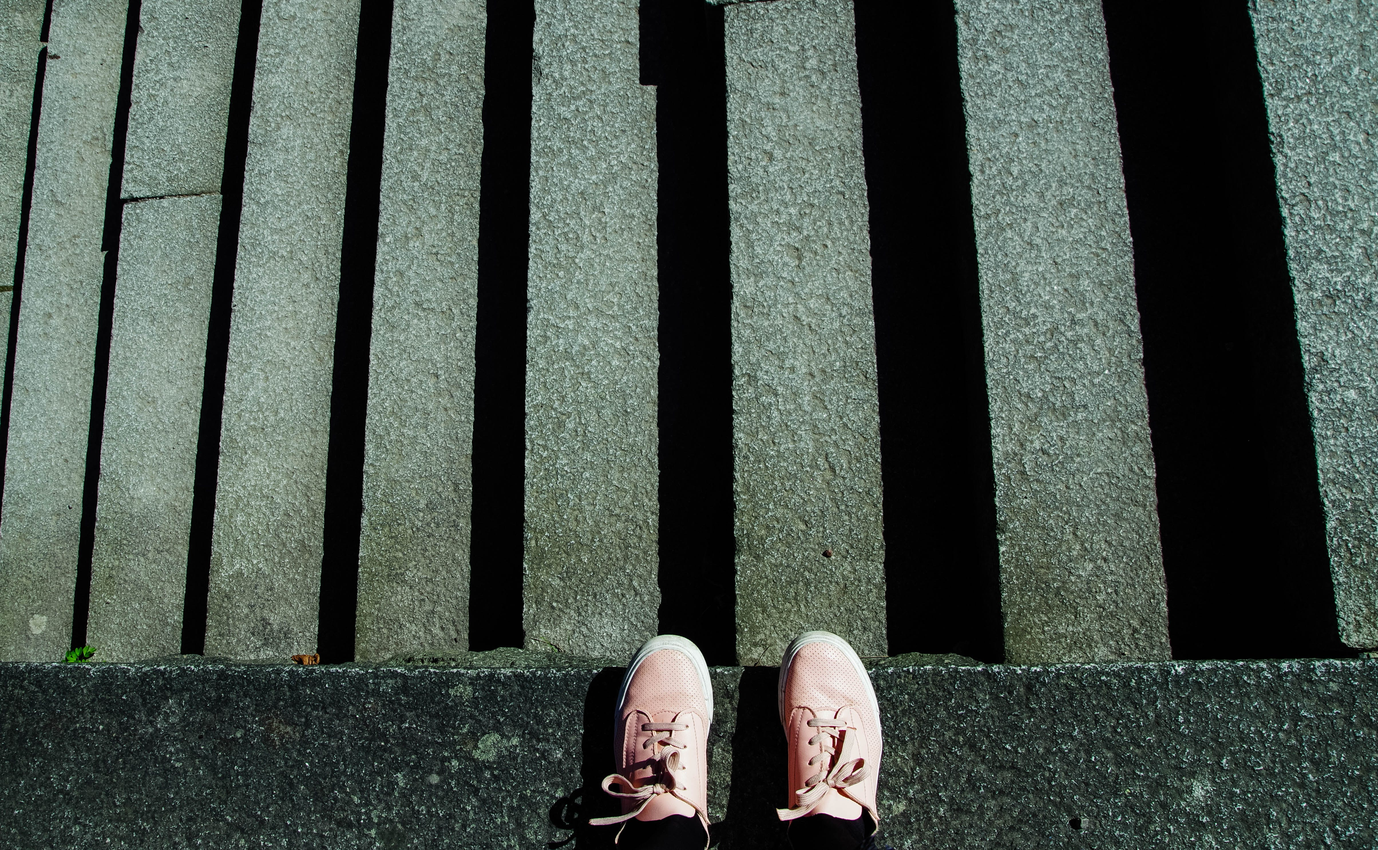 Photography of Shoes Near Stairs