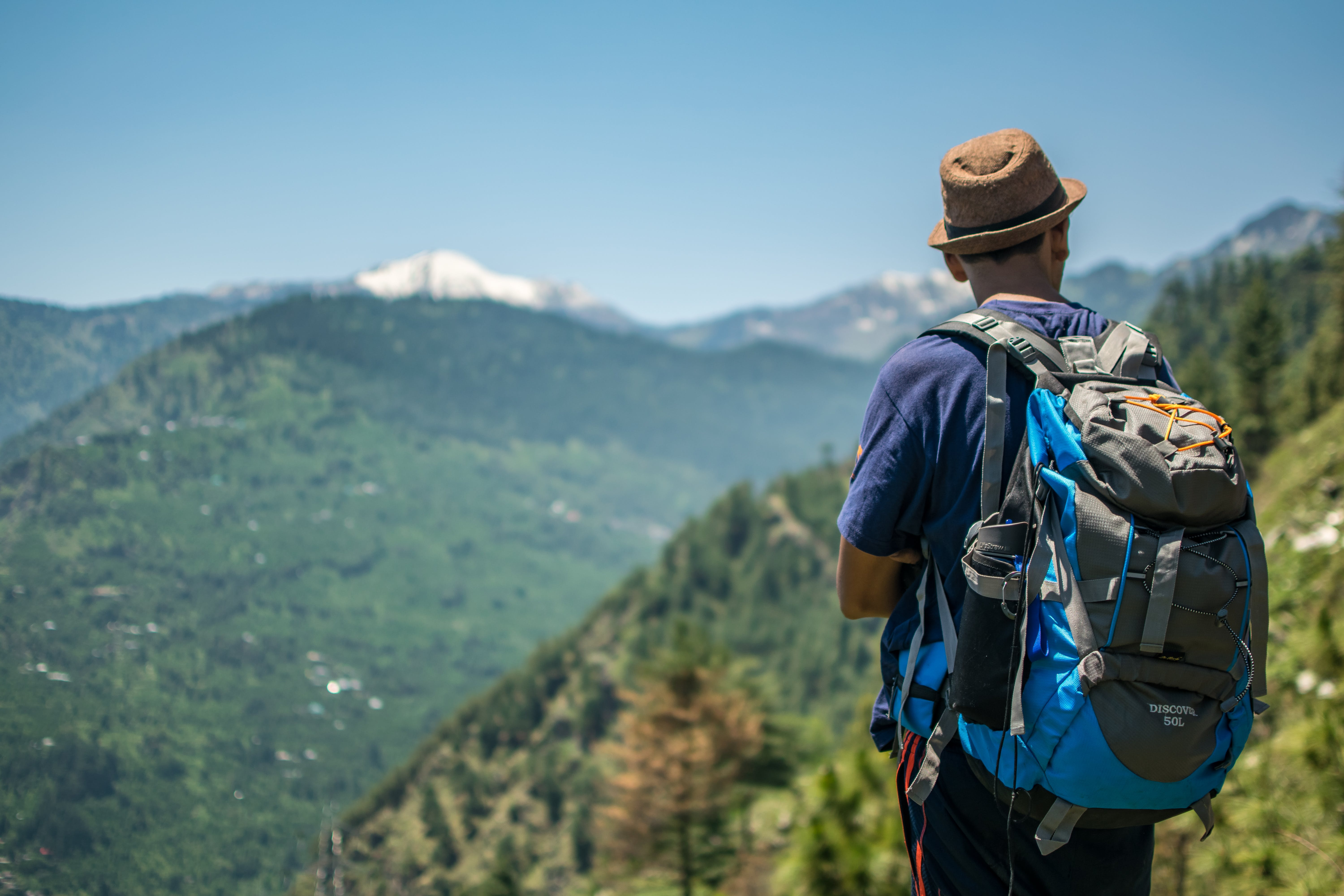 Selective Focus Photography of Man Carrying Hiking Pack