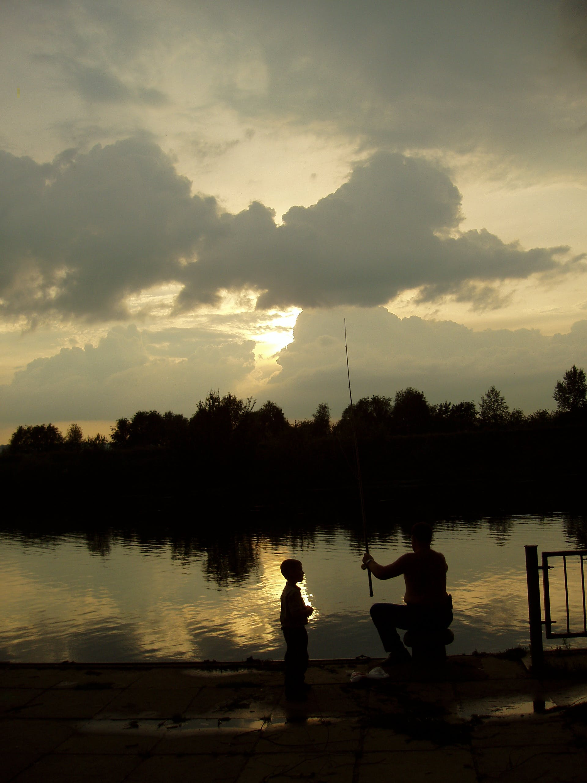 Free stock photo of dark, evening, father with son, fisherman
