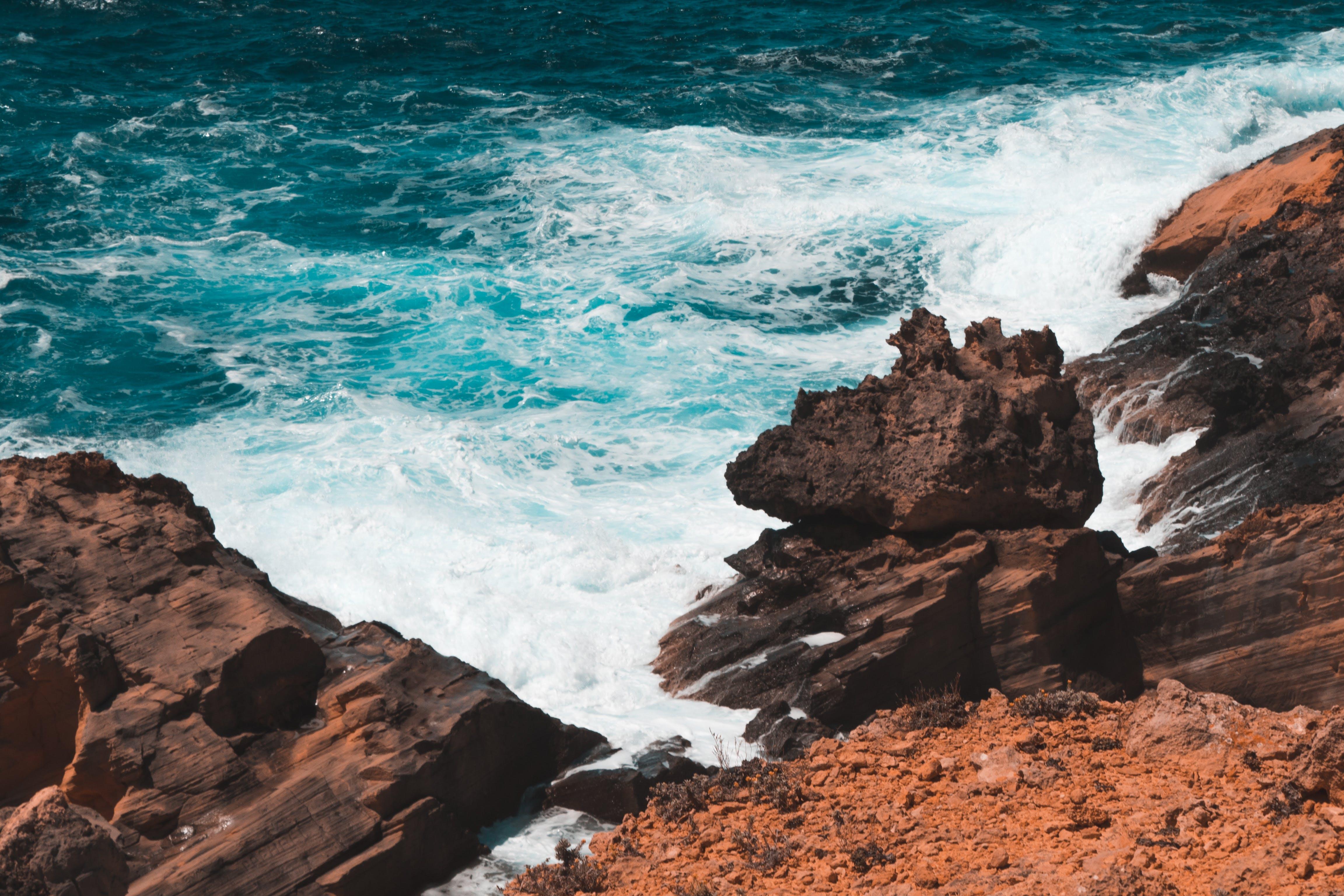 Photo of Rocks Formation on Seashore