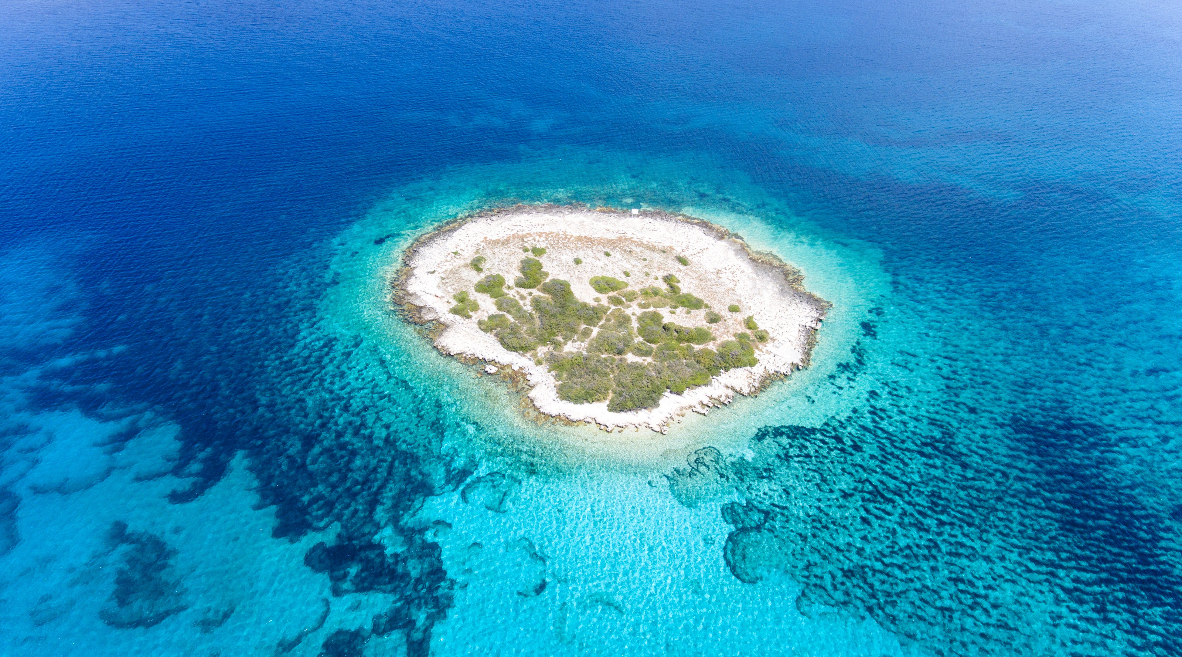 Aerial View Photography of Islet Surround by Body of Water