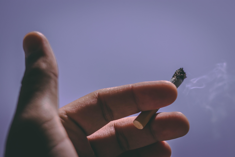 Person Holding Single Cigarette