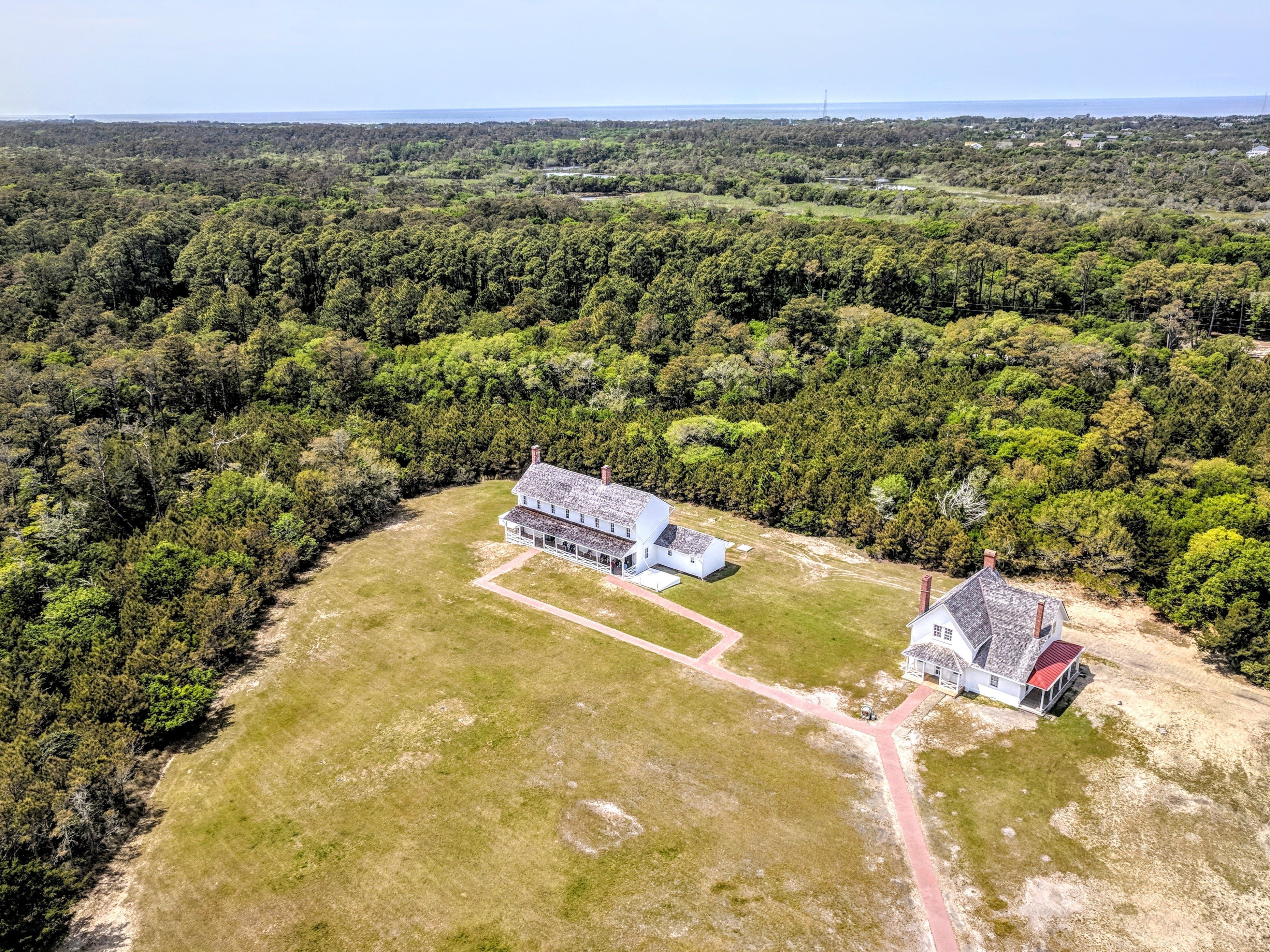 Aerial Photography of Two Houses Surrounded With Plants and Trees