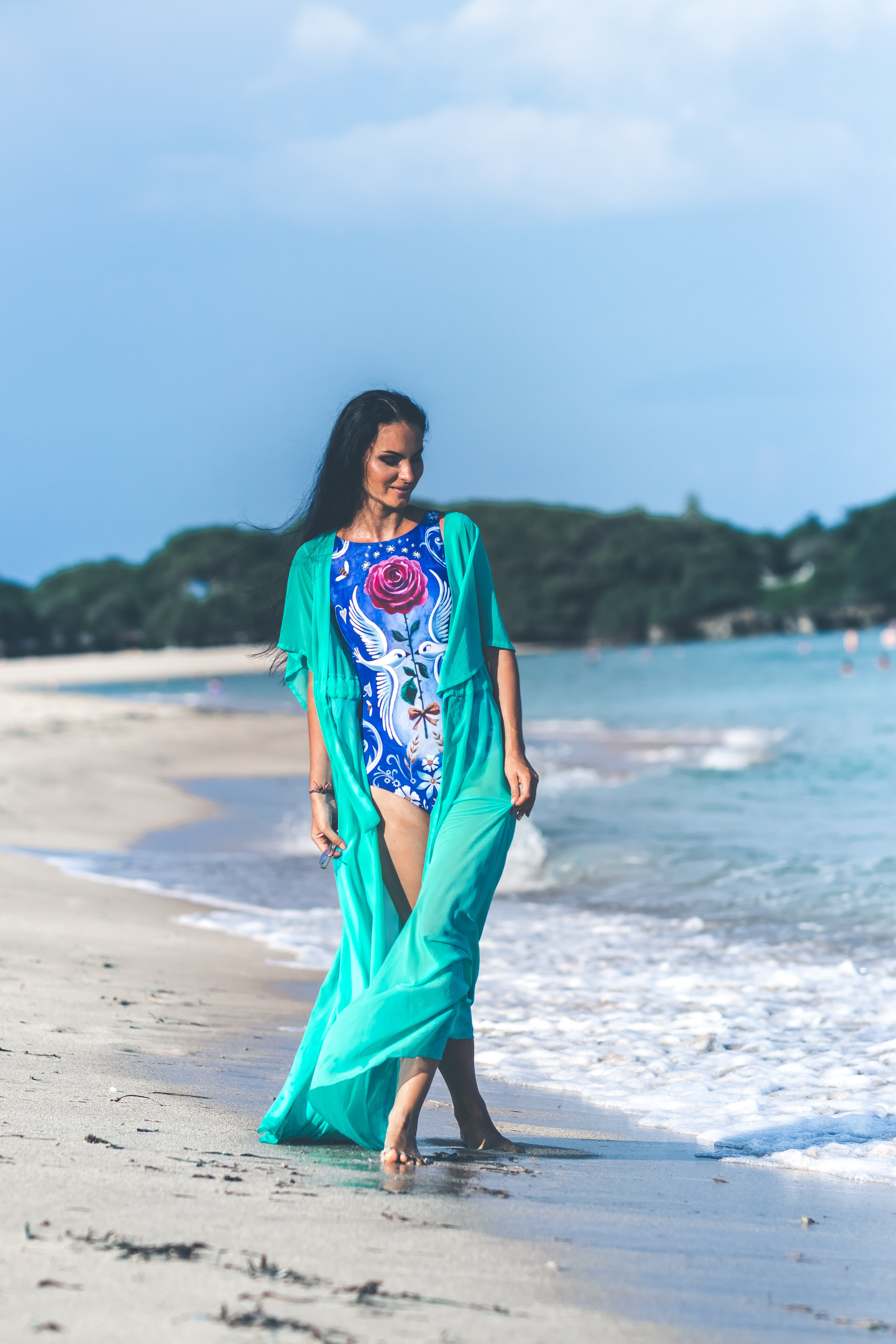 Woman in Blue and Pink Floral Monokini Standing at the Seashore