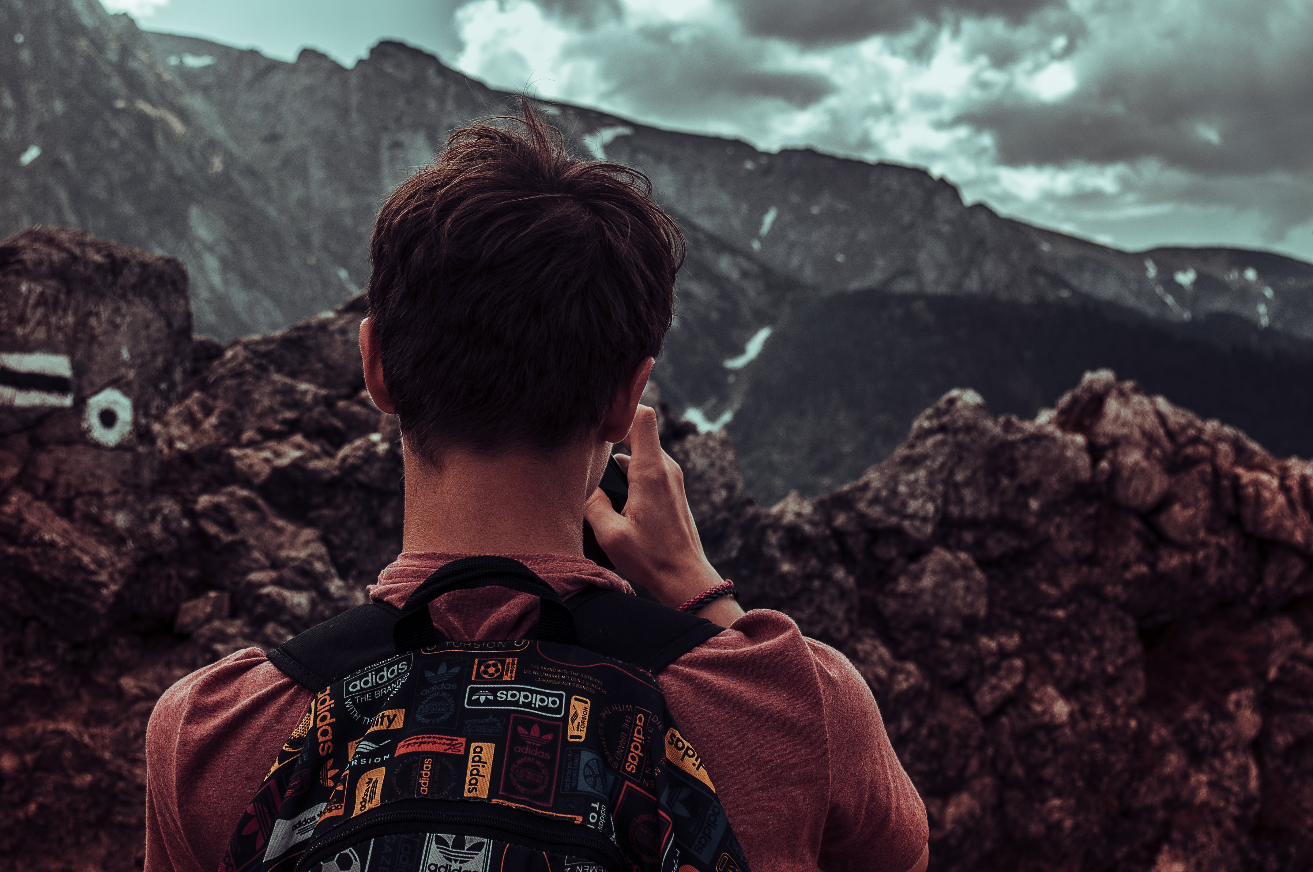 Man Taking Photos Of Mountains