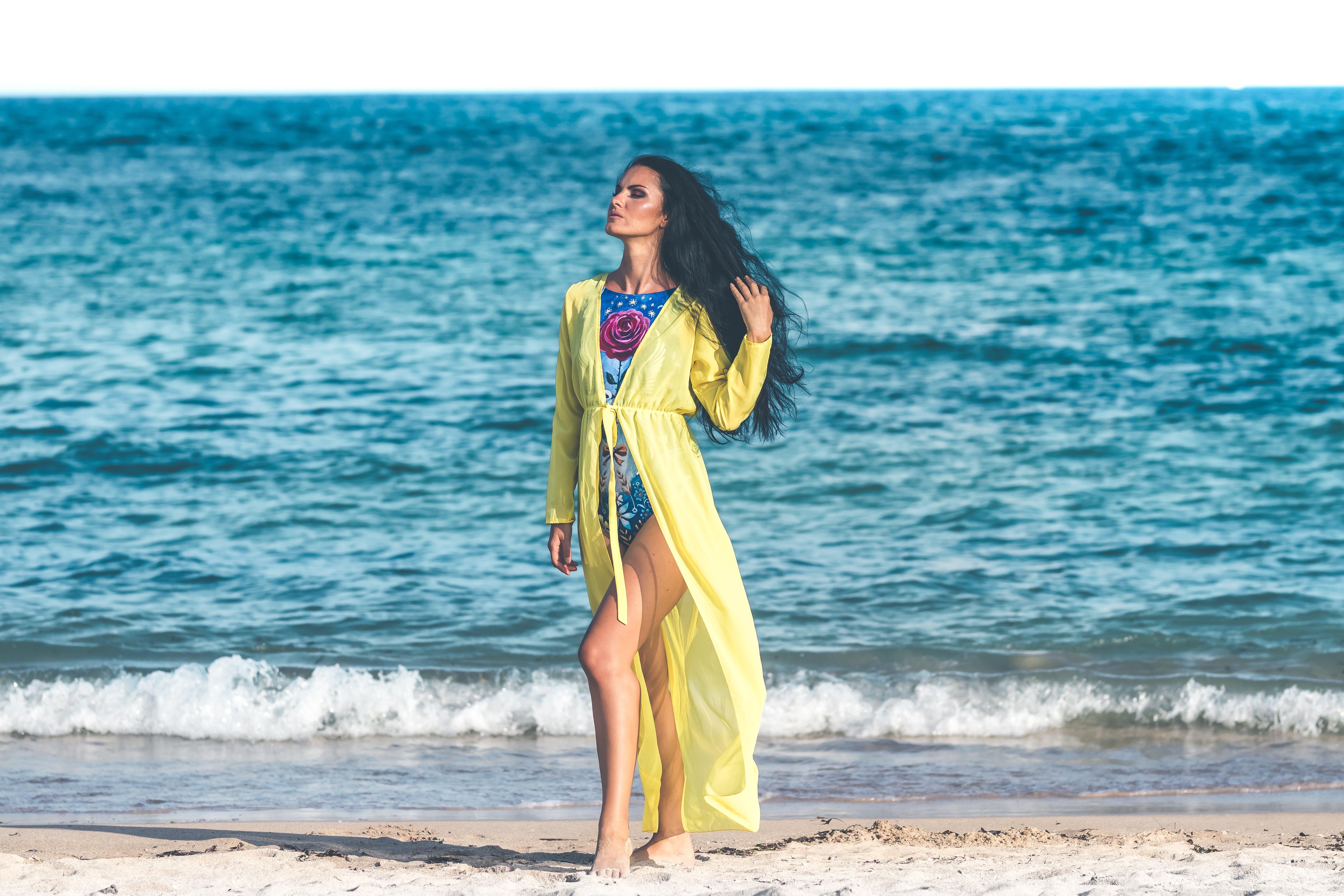 Woman Wearing Blue Monokini Standing on Beach Sand