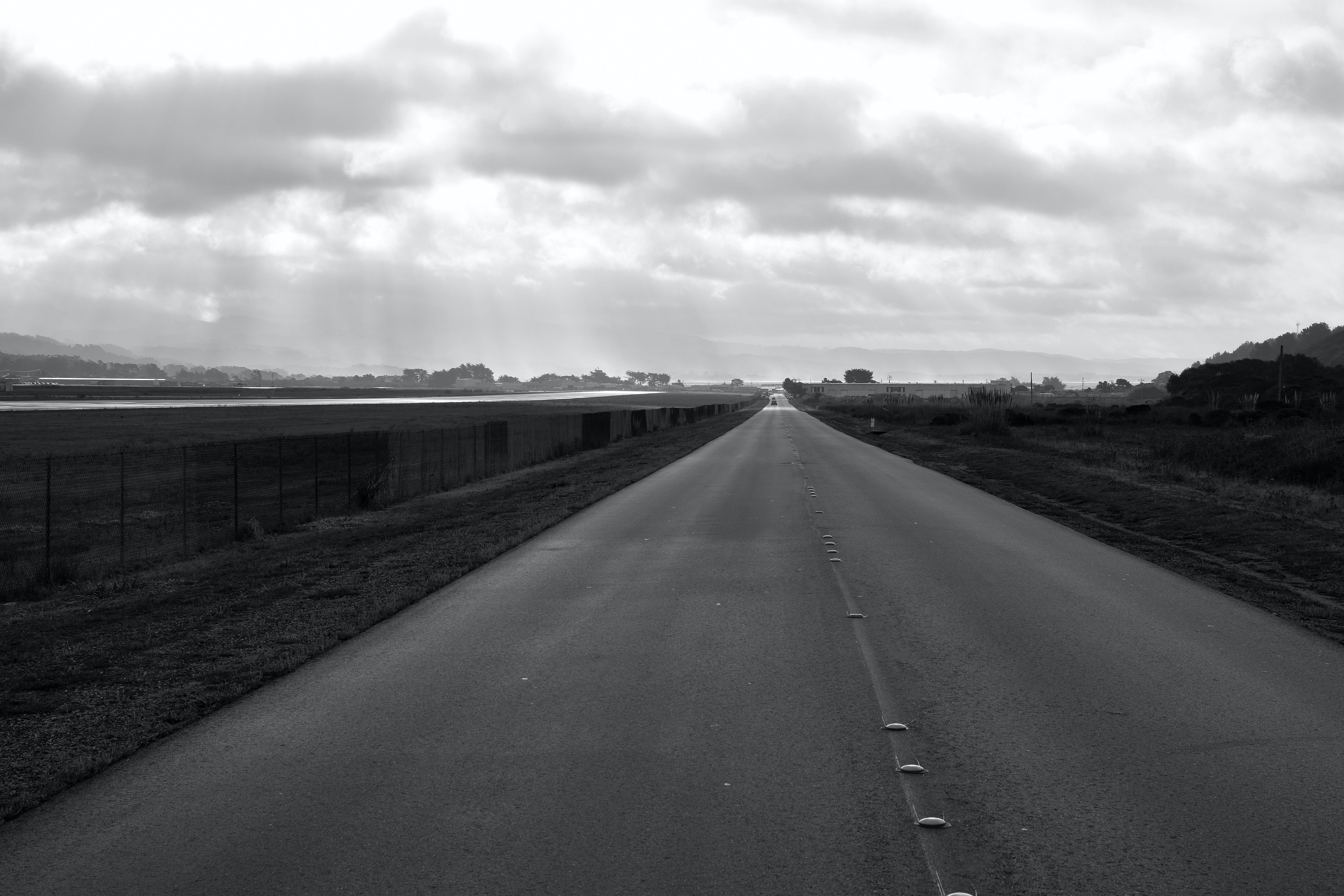 Grayscale Gray Concrete Road at Daytime