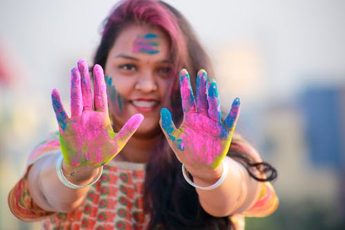 Woman Showing Her Hands With Assorted Color Paints