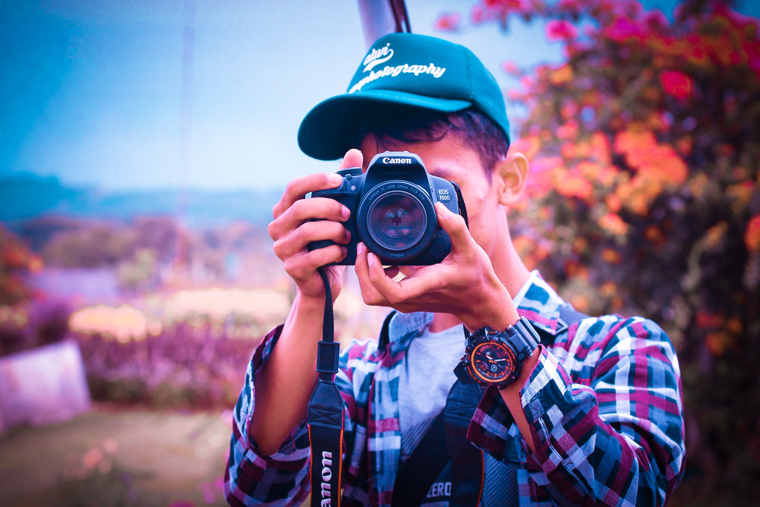 Shallow Focus Photography of a Man Holding Camera