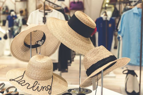 Four Brown Straw Hats Display