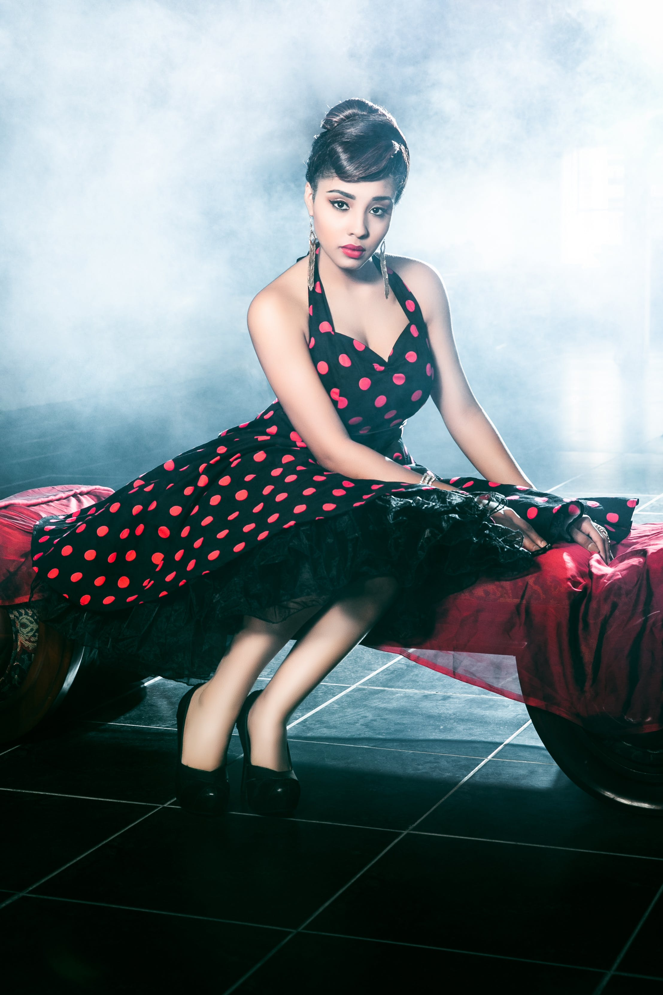 Woman Wearing Black and Red Polka-dot Dress