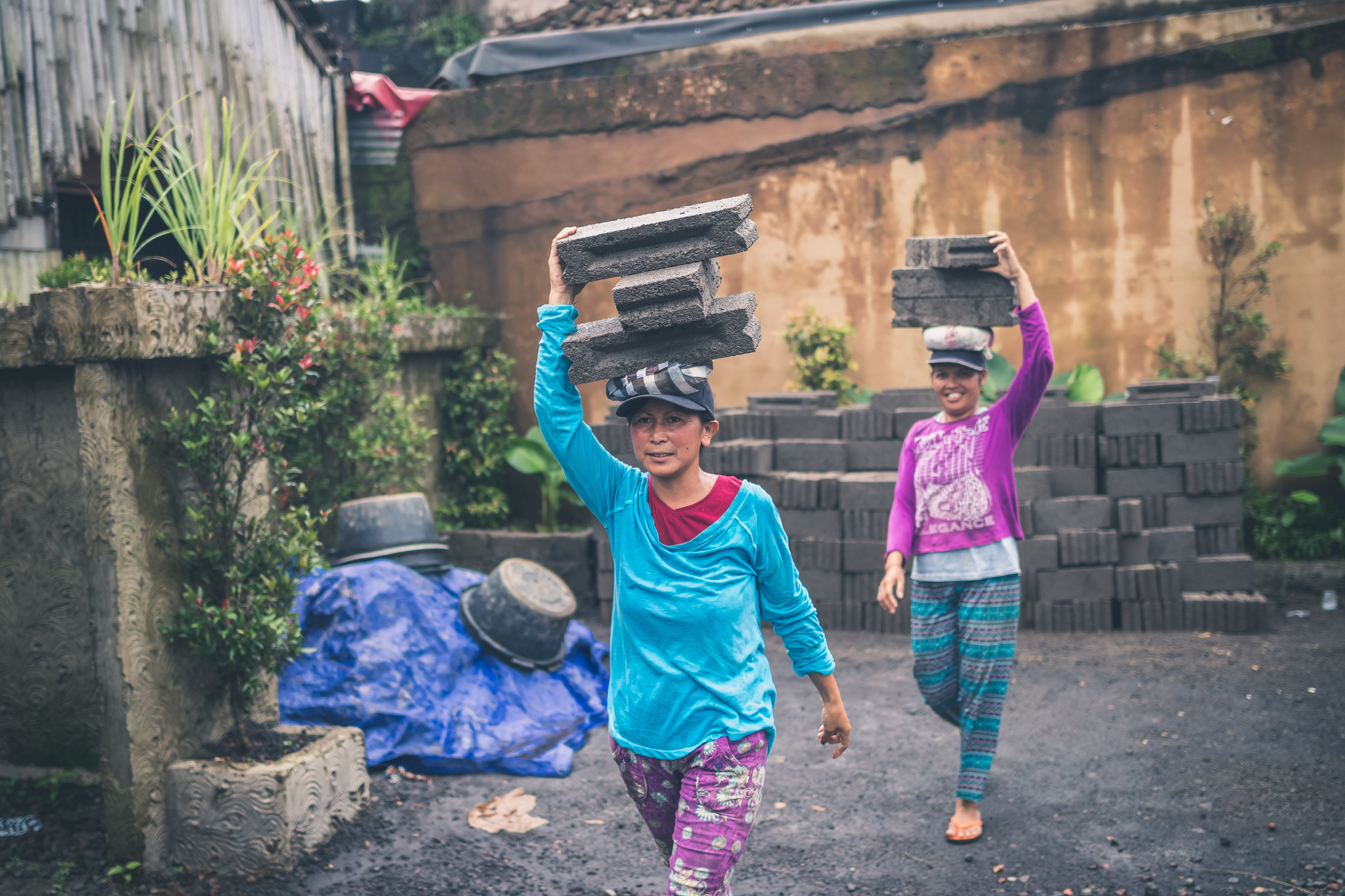 Photography of Women Carrying Cinder Blocks