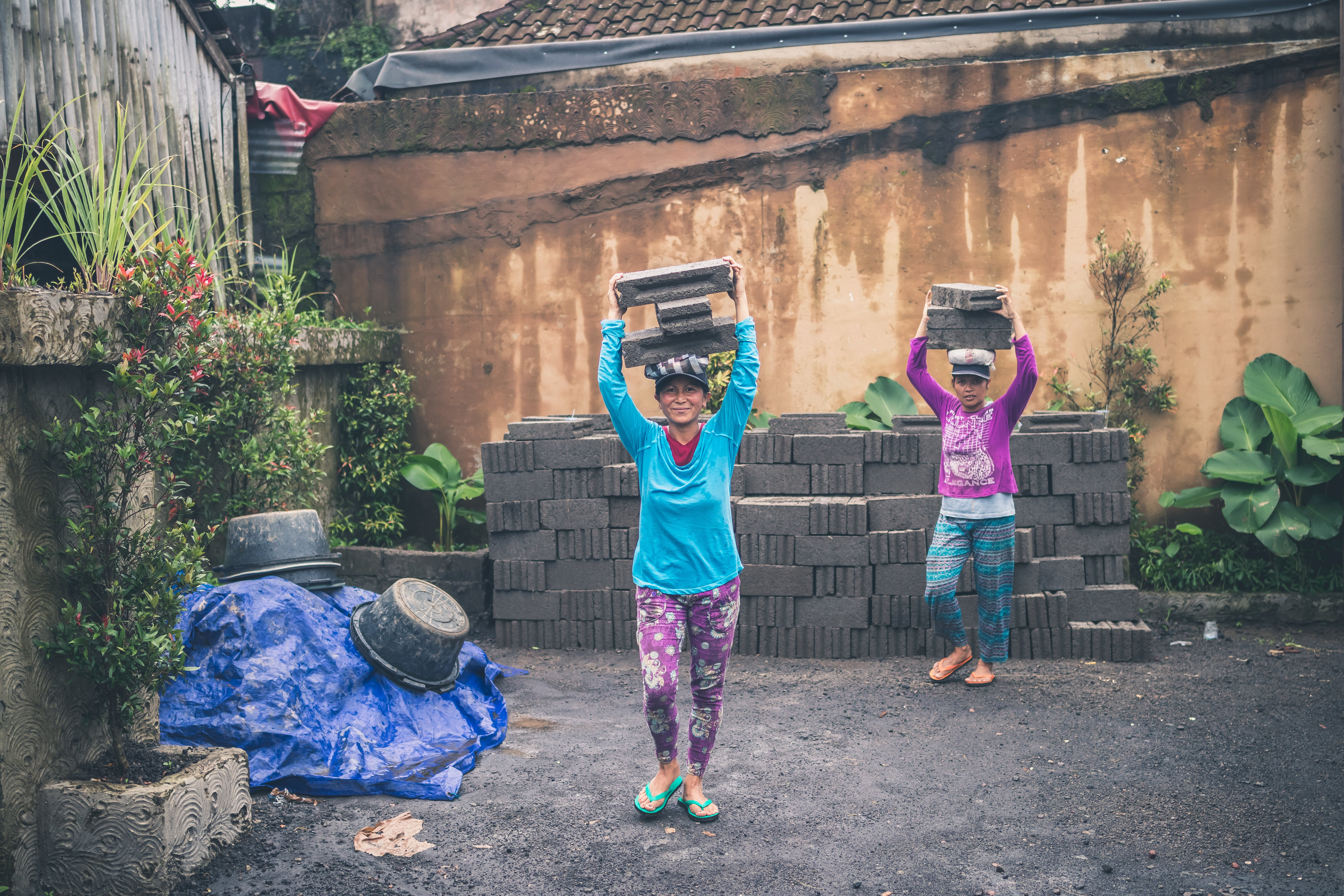 Photography of People Carrying Cinder Blocks