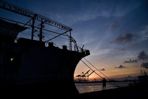 Silhouette Of Ship Docked
