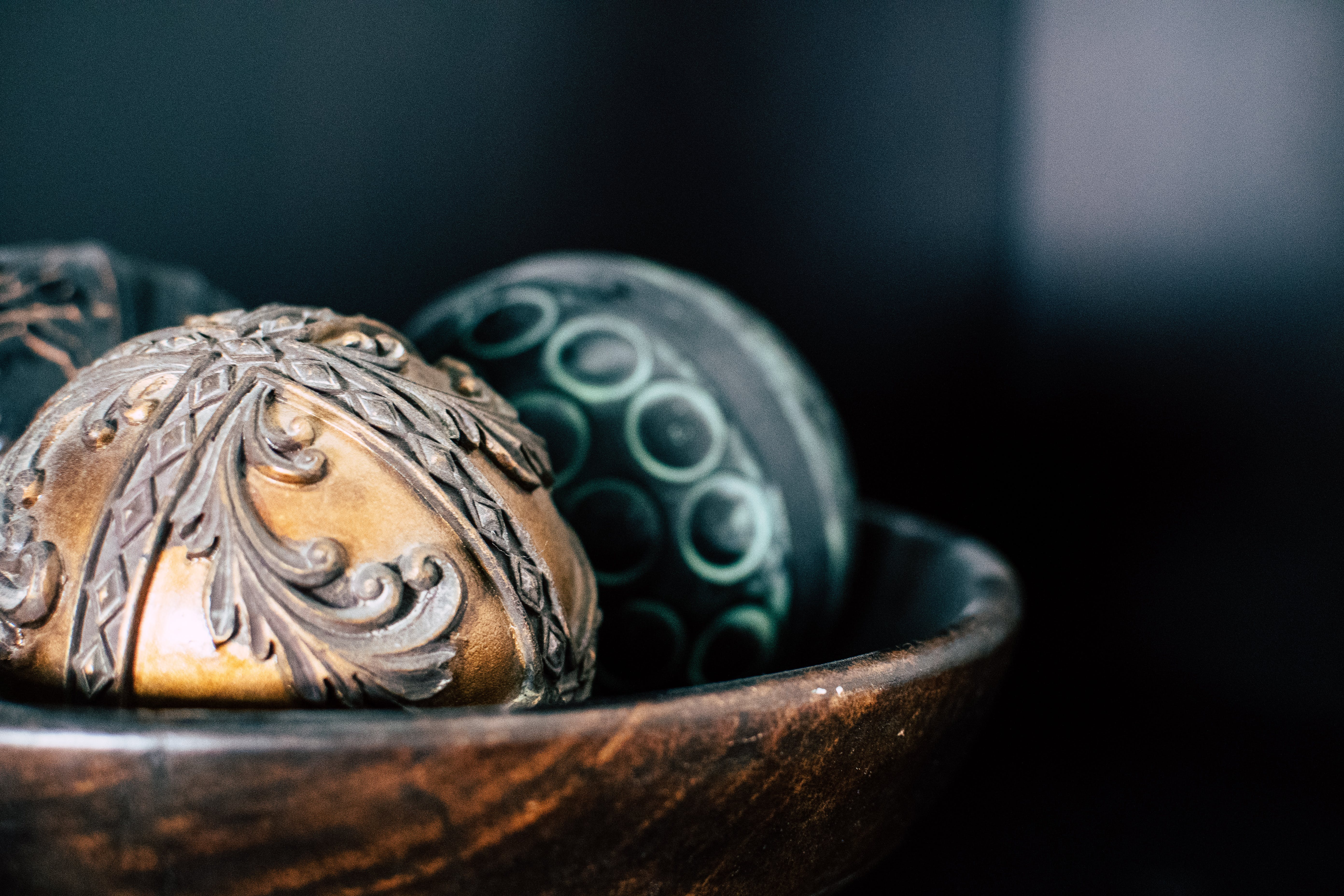 Brown and Two Black Ball in Bowl Photography