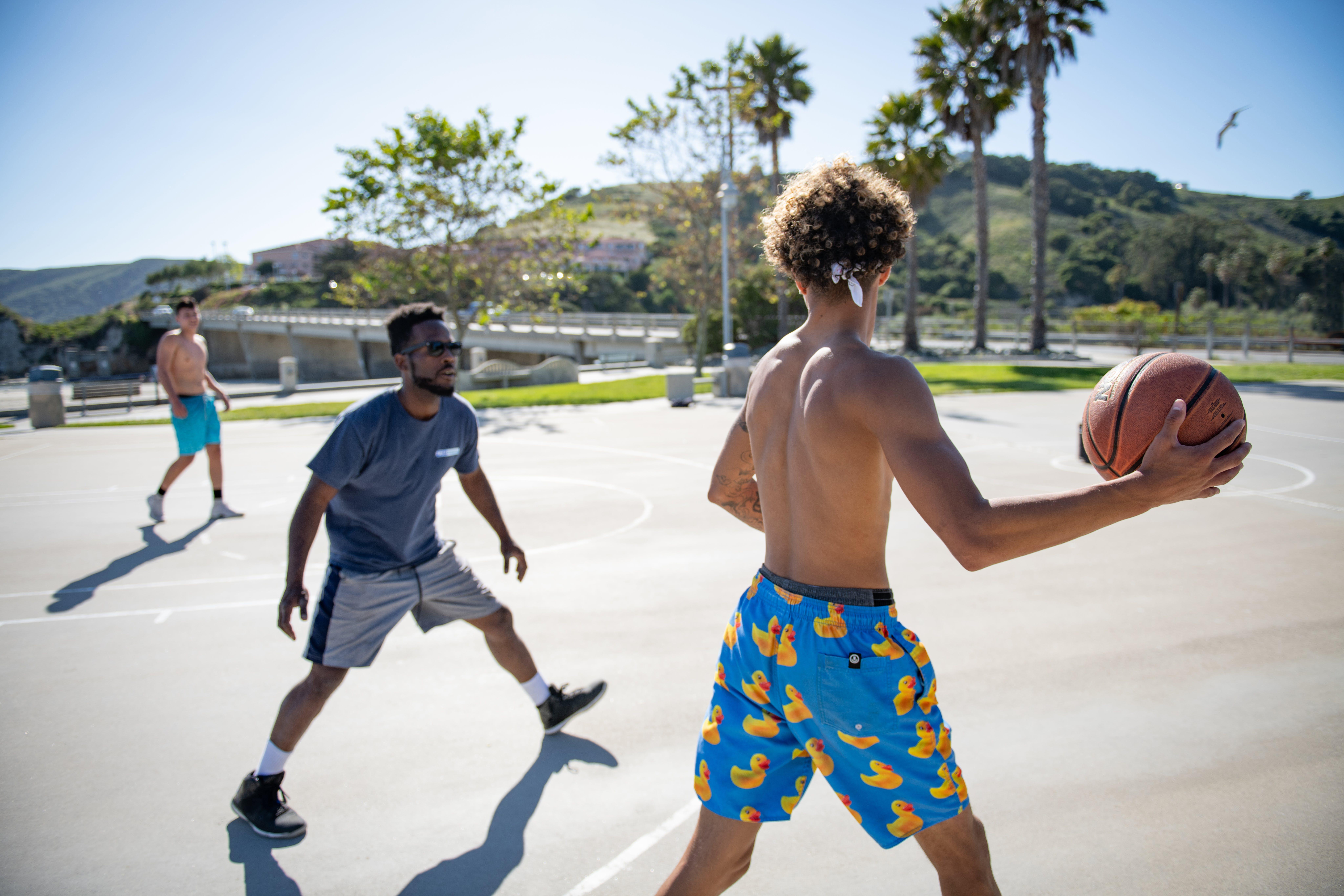 Three Man Playing Basketball
