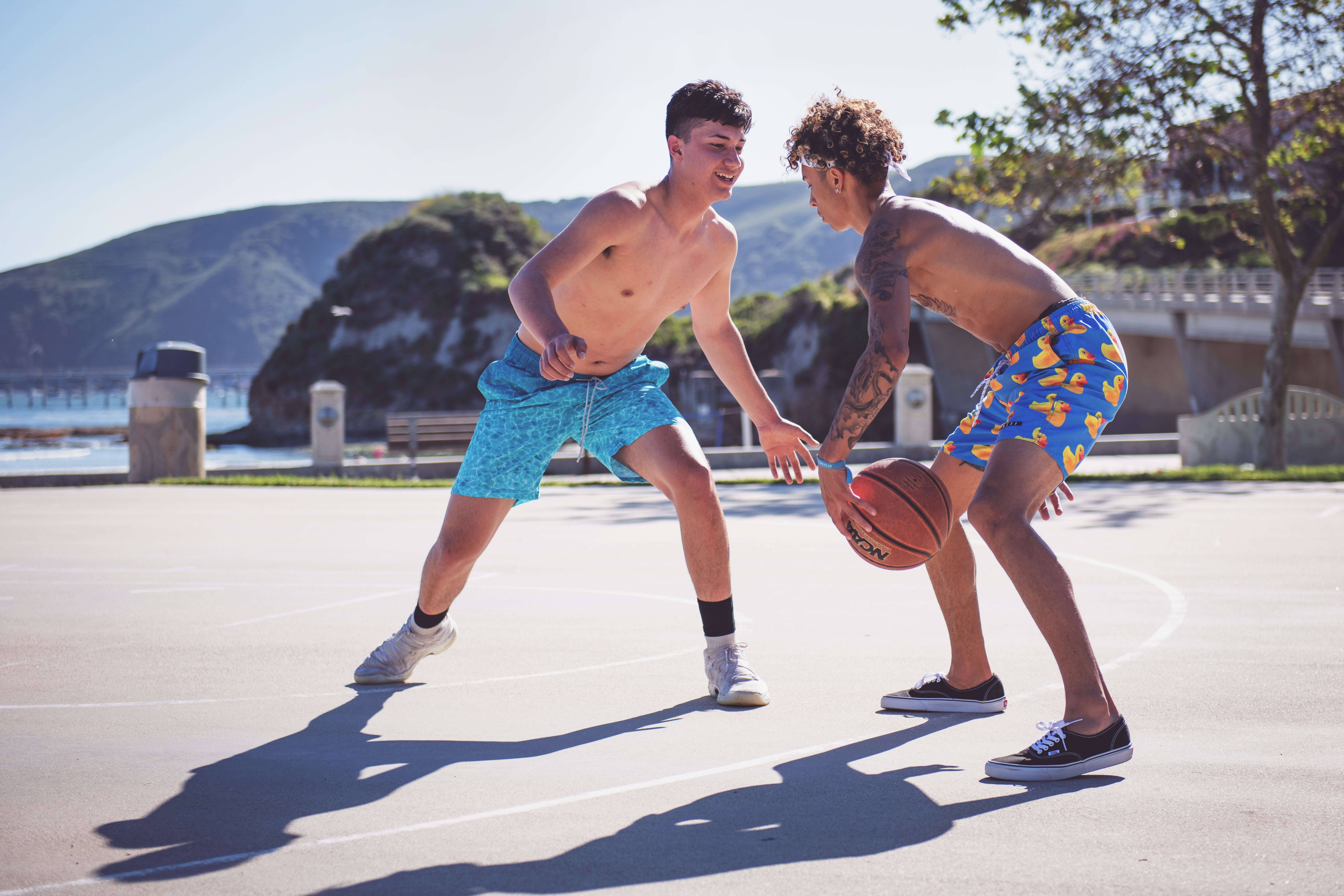 Photo Of Two Men Playing Basketball