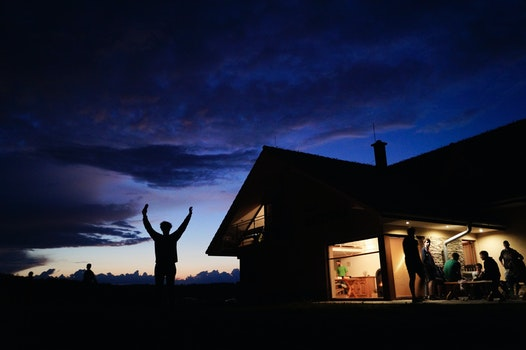 Silhoutte of Person Standing during Night Time