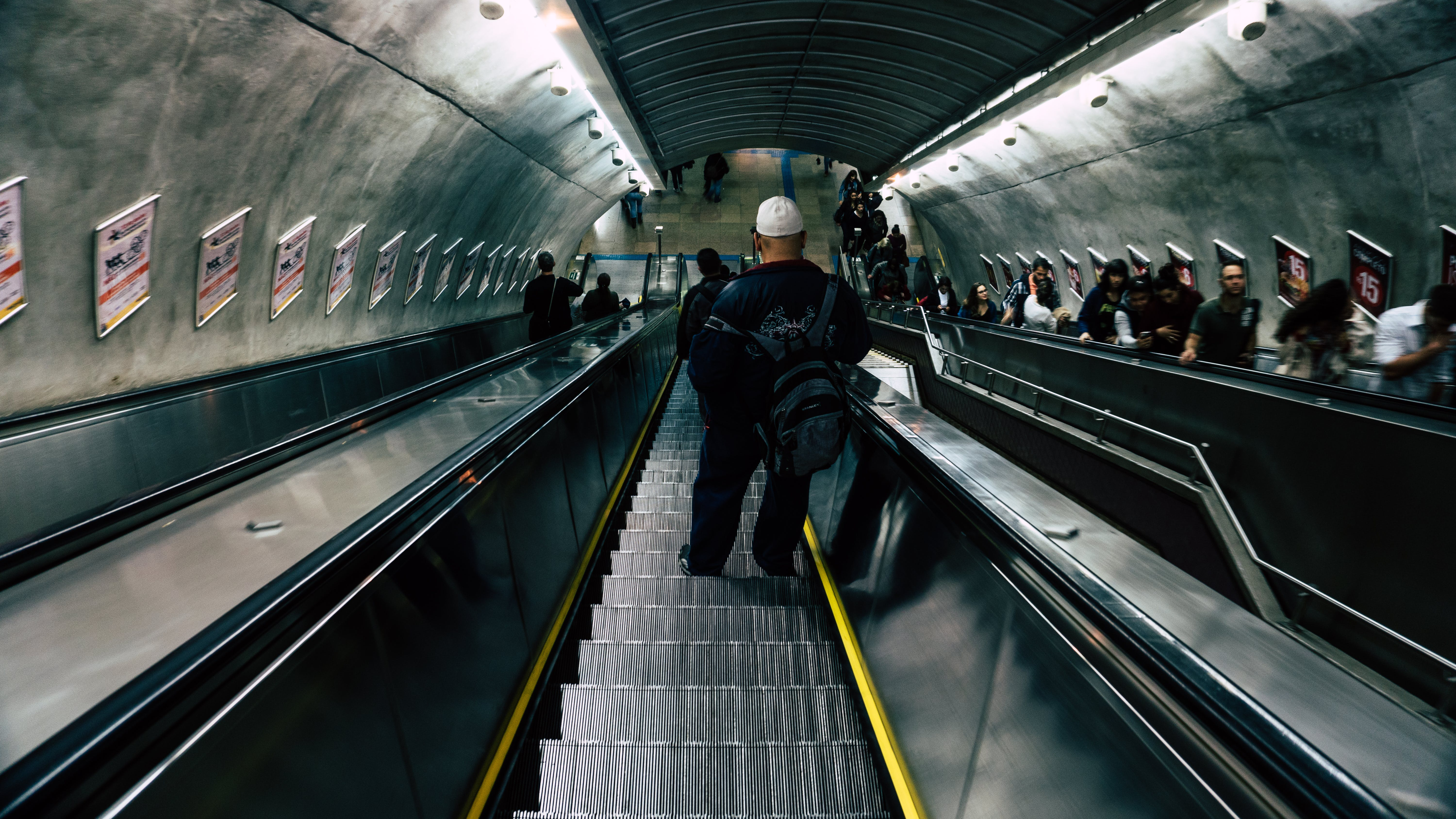 Man in Black Leather Jacket on Escalator