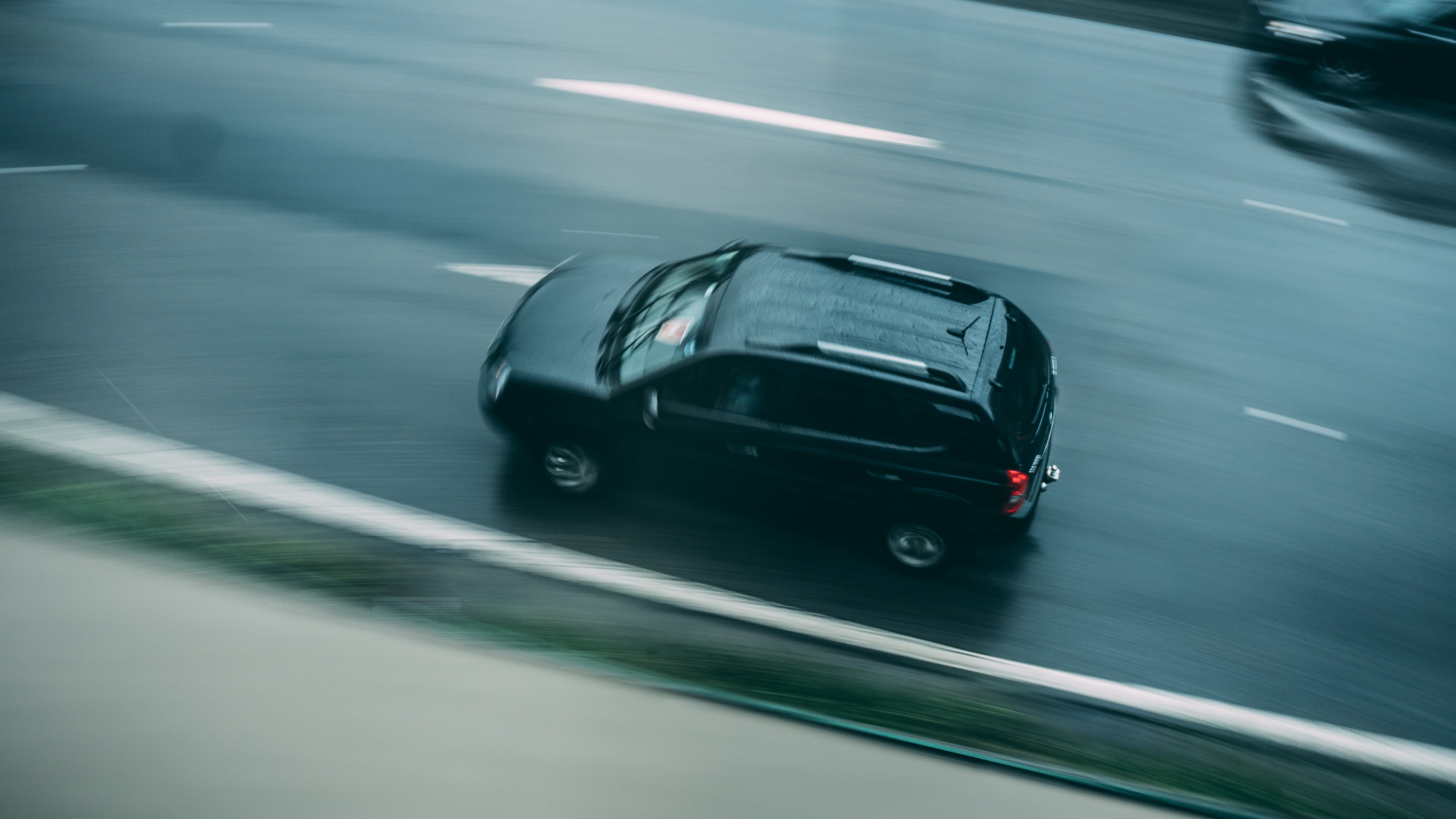 Aerial View of Black Suv Running on Road
