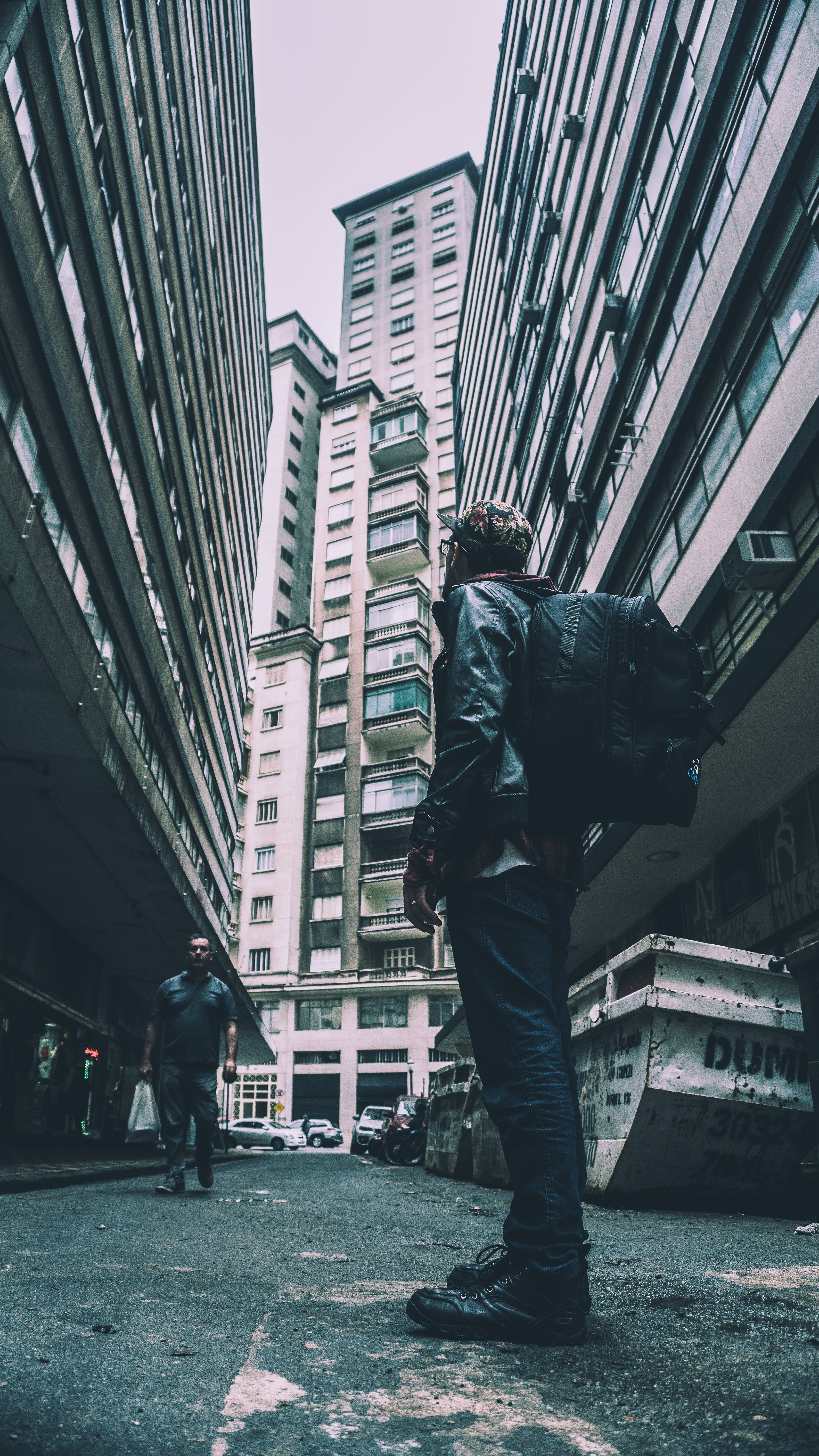 Man Standing in Between Buildings
