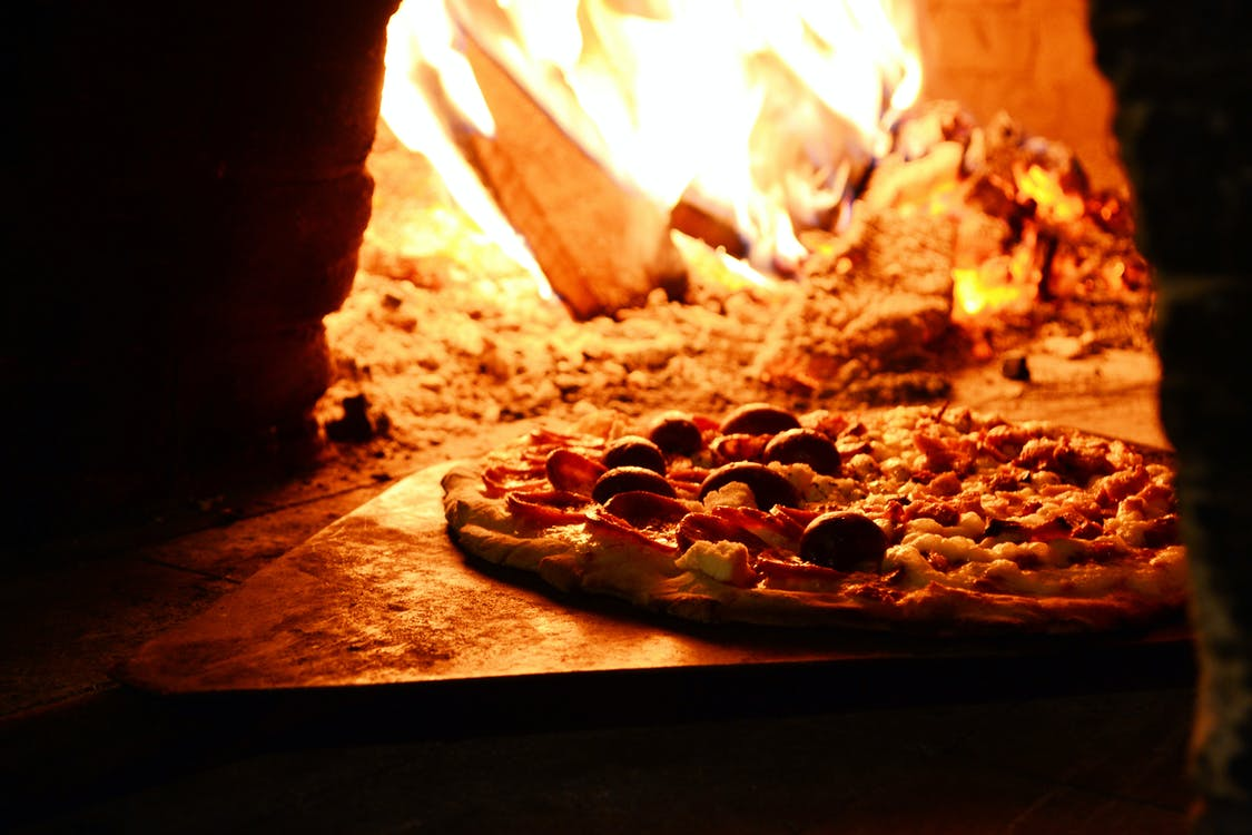 Close-up Photo of Pizza Near Bonfire