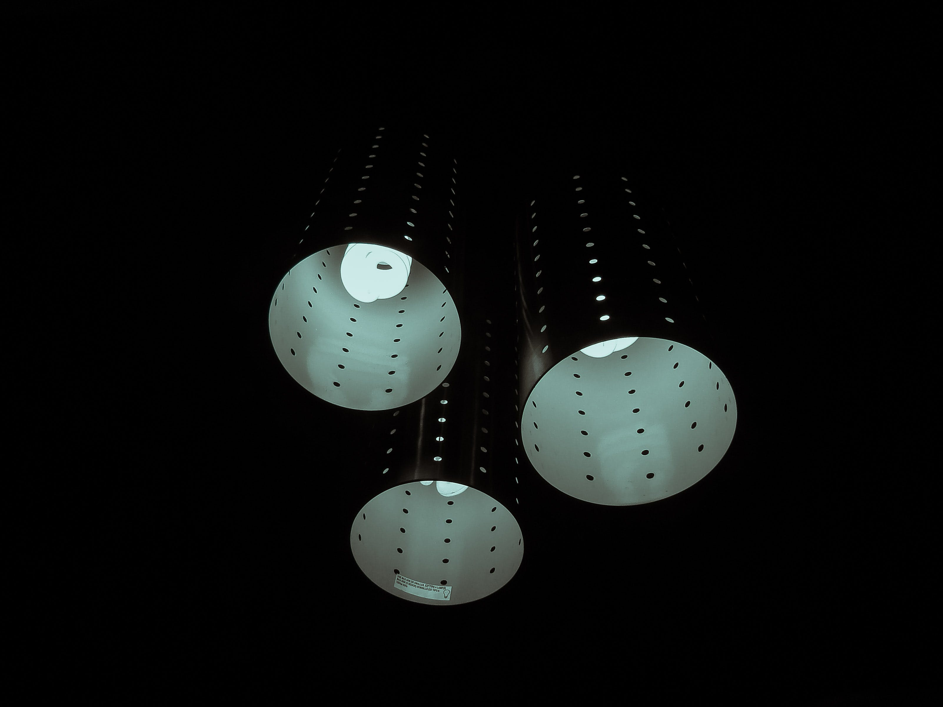 Photography of Three Lamps on Dark Room