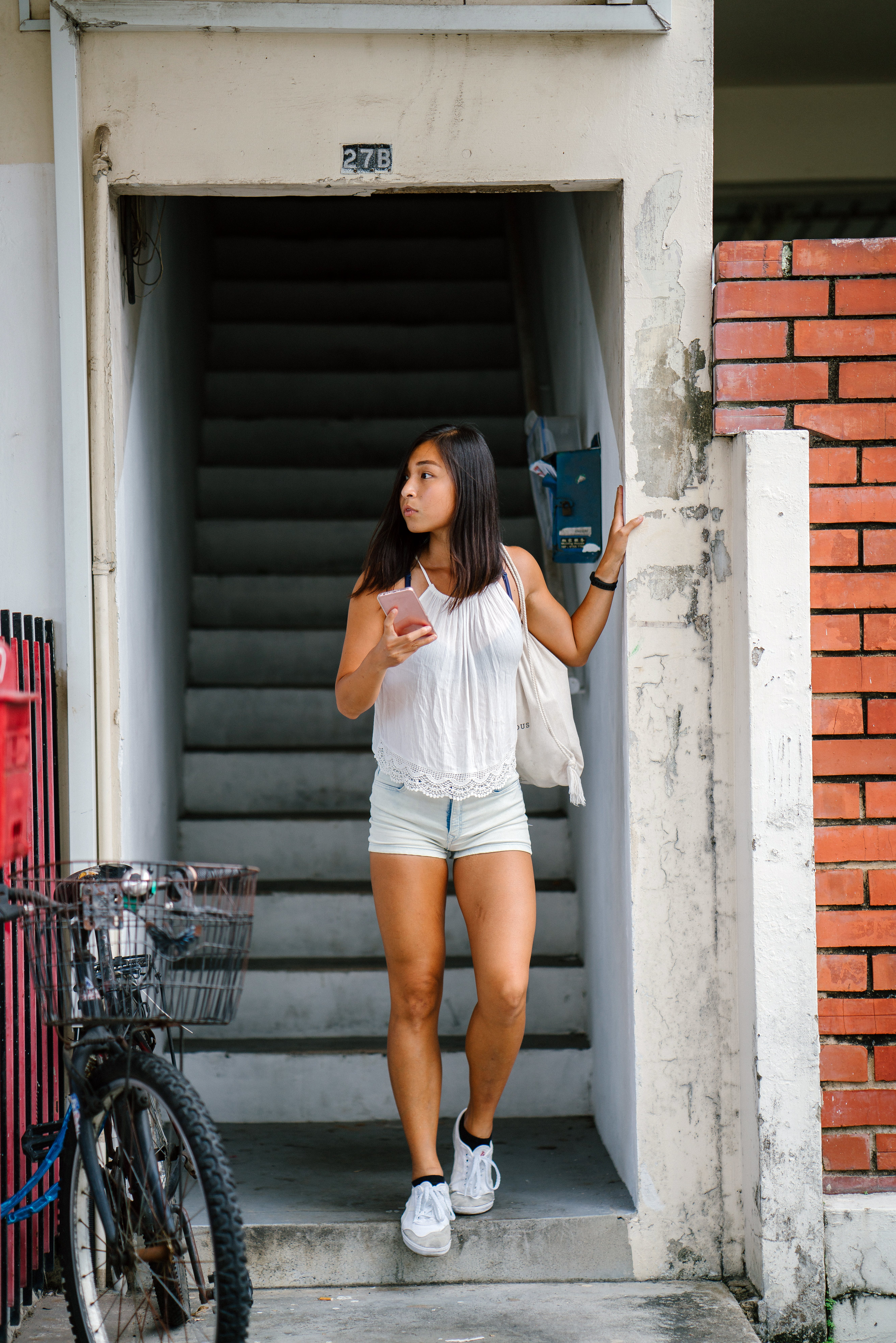 Woman Wearing White Top Holding Smartphone