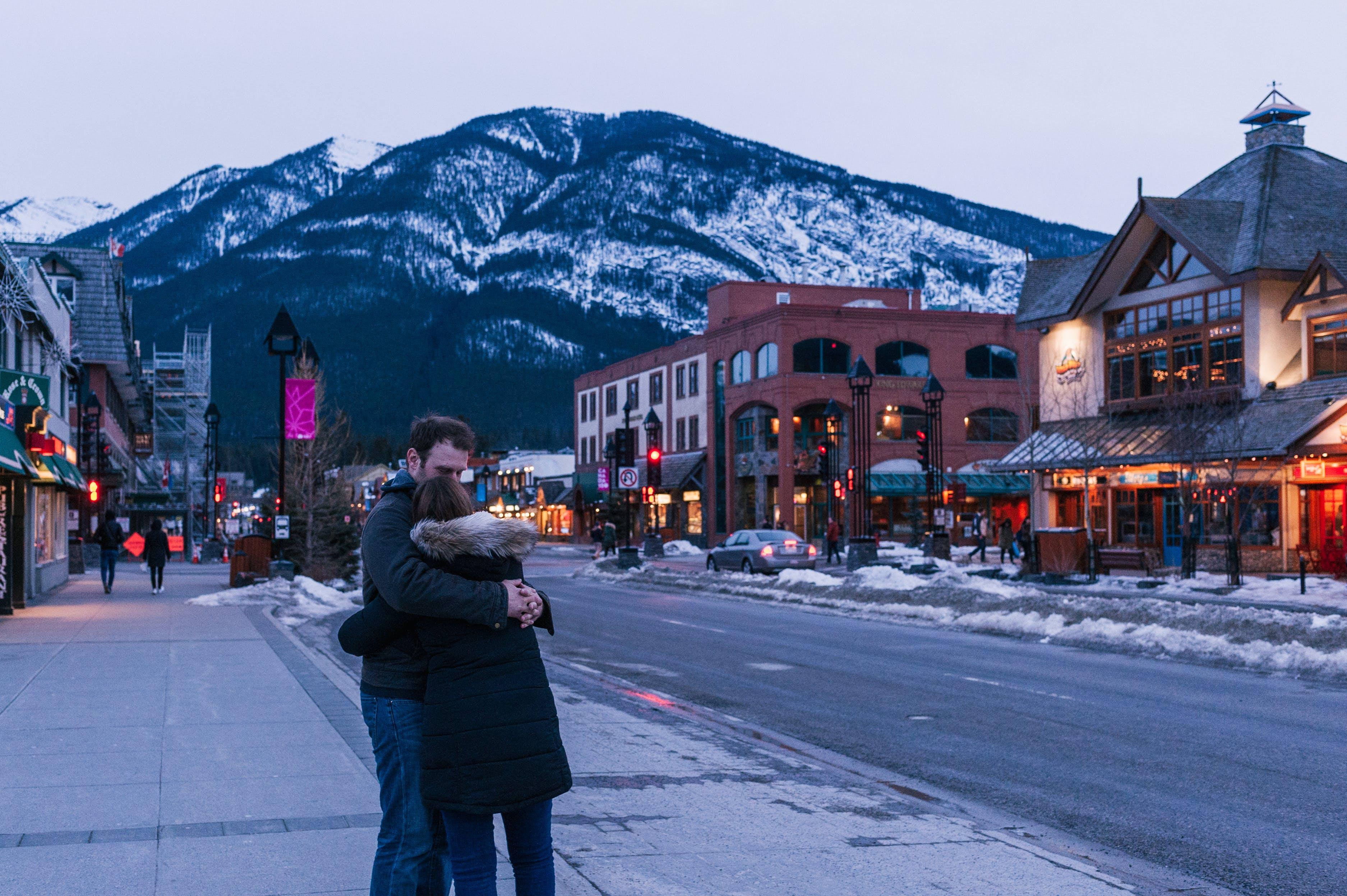 Man Hugging Woman on Street