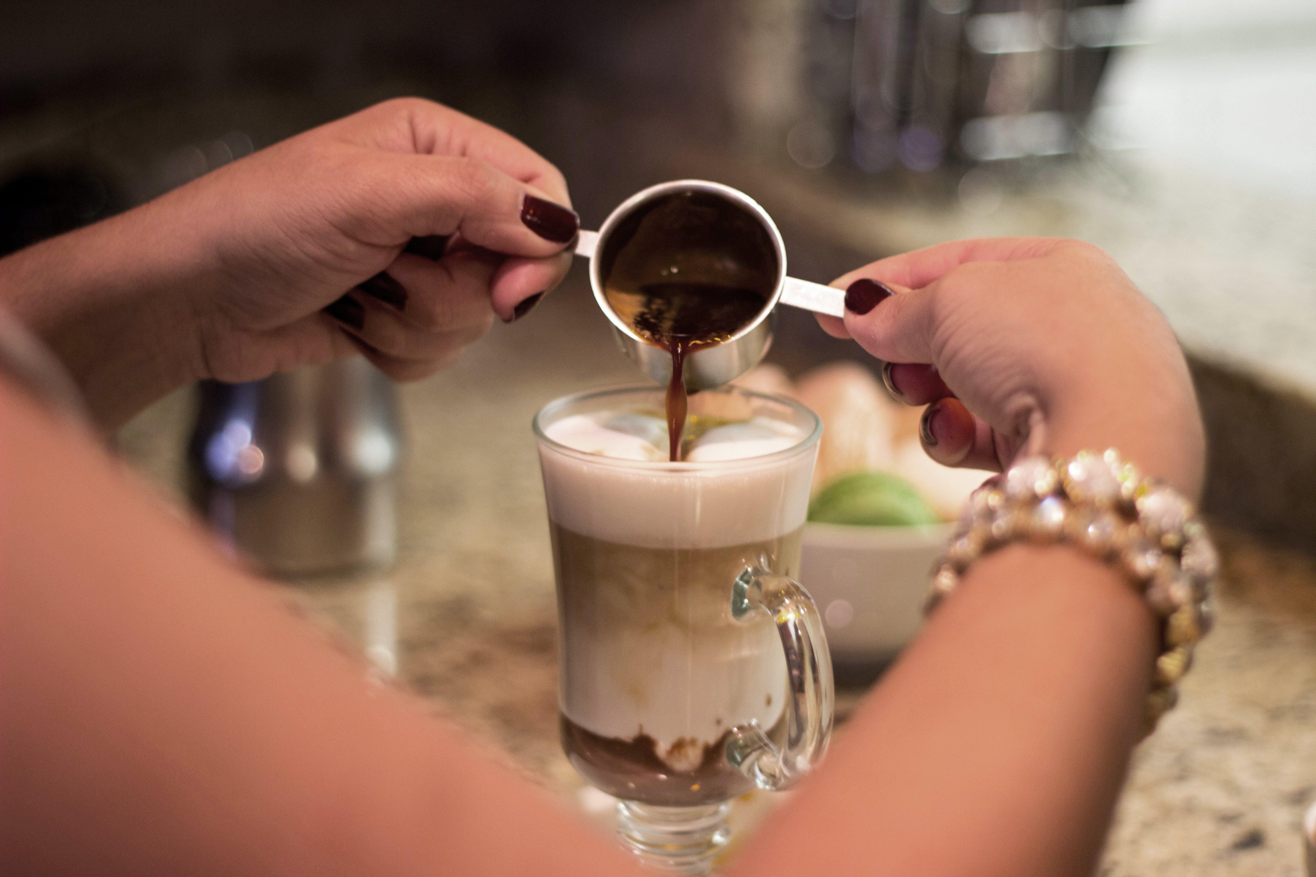 Person Making a Cappuccino Coffee