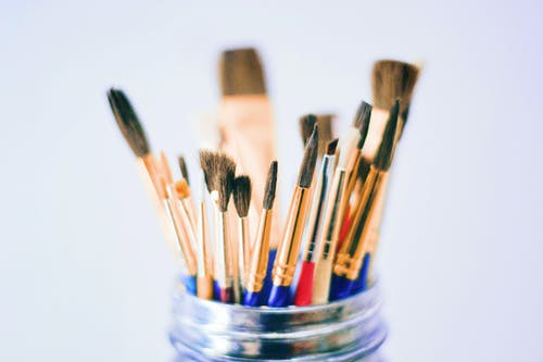 Shallow Photography of Brushes on Jar