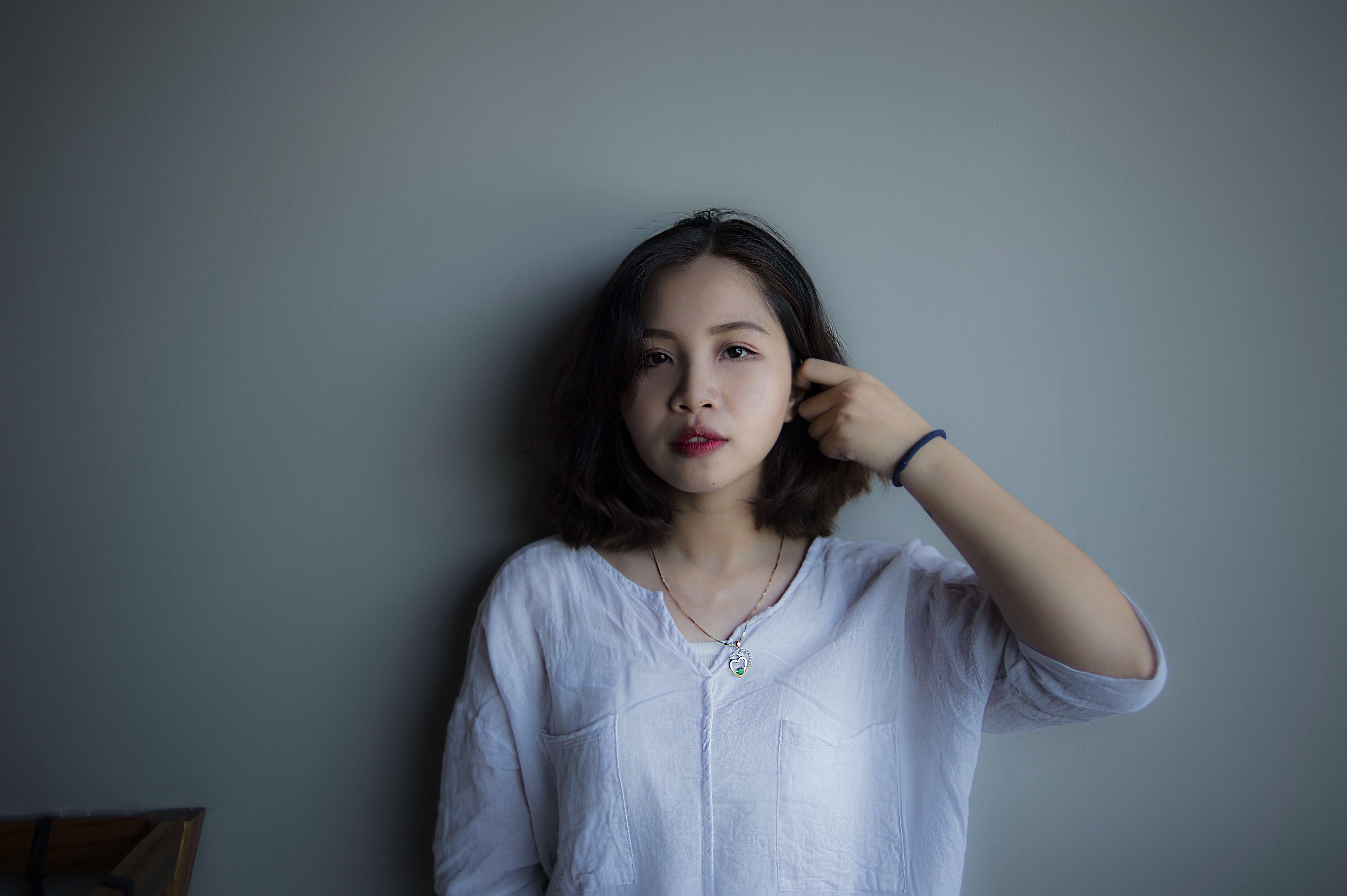 Woman Wearing Blue Long-sleeved Shirt