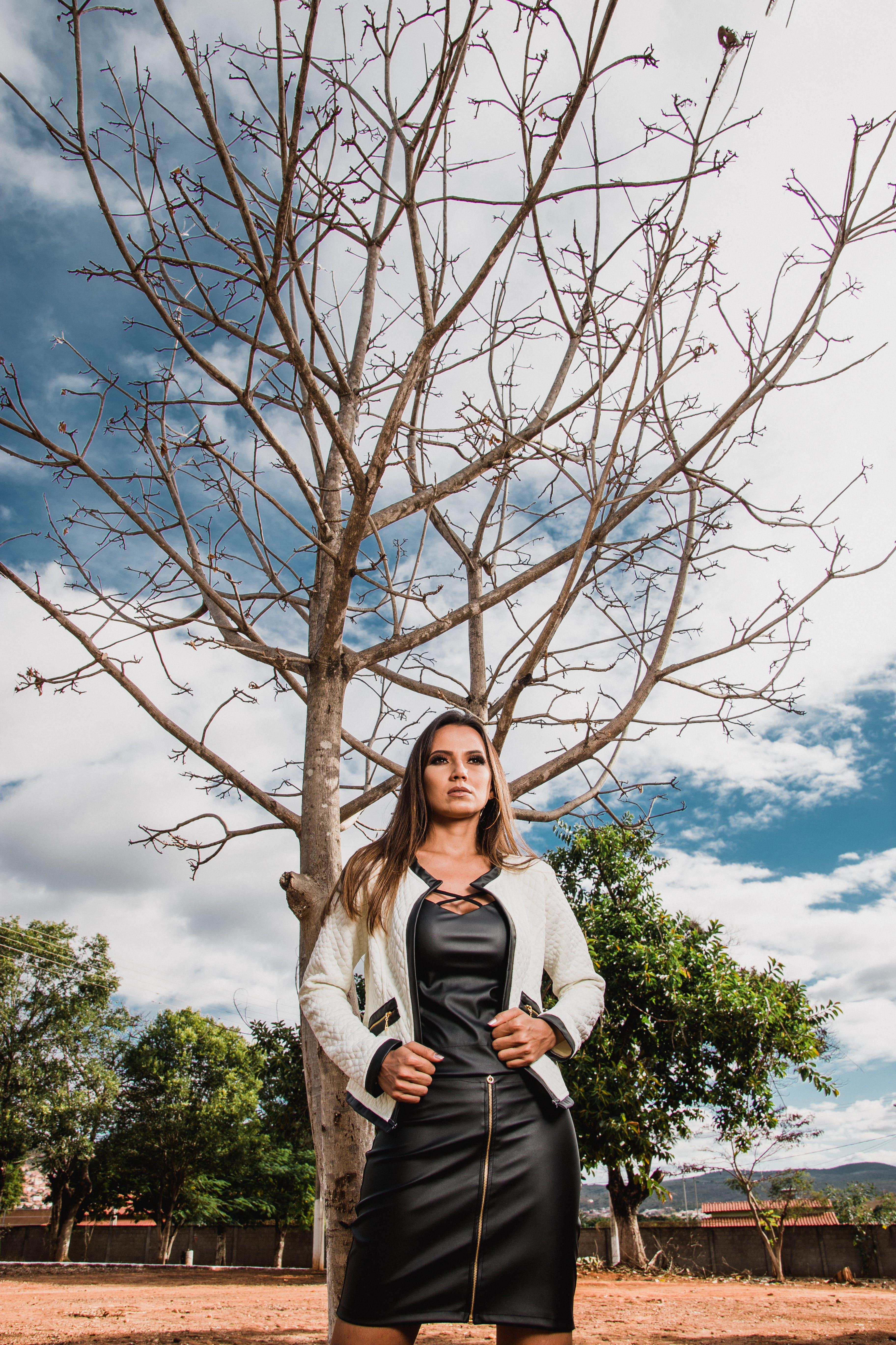 Photo Of Woman Standing Near Tree