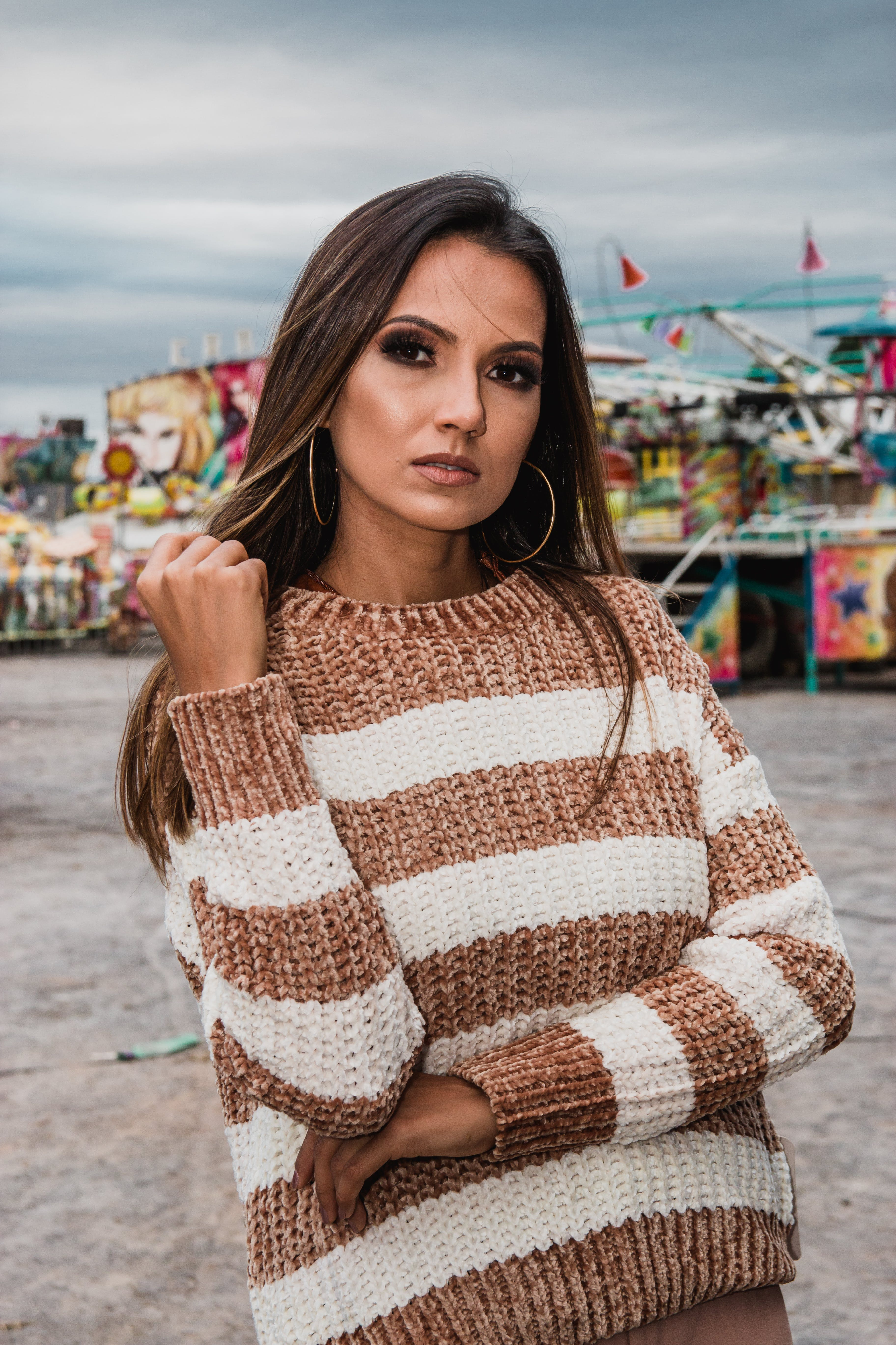 Woman Wearing Knitted White And Brown Stripe Sweater