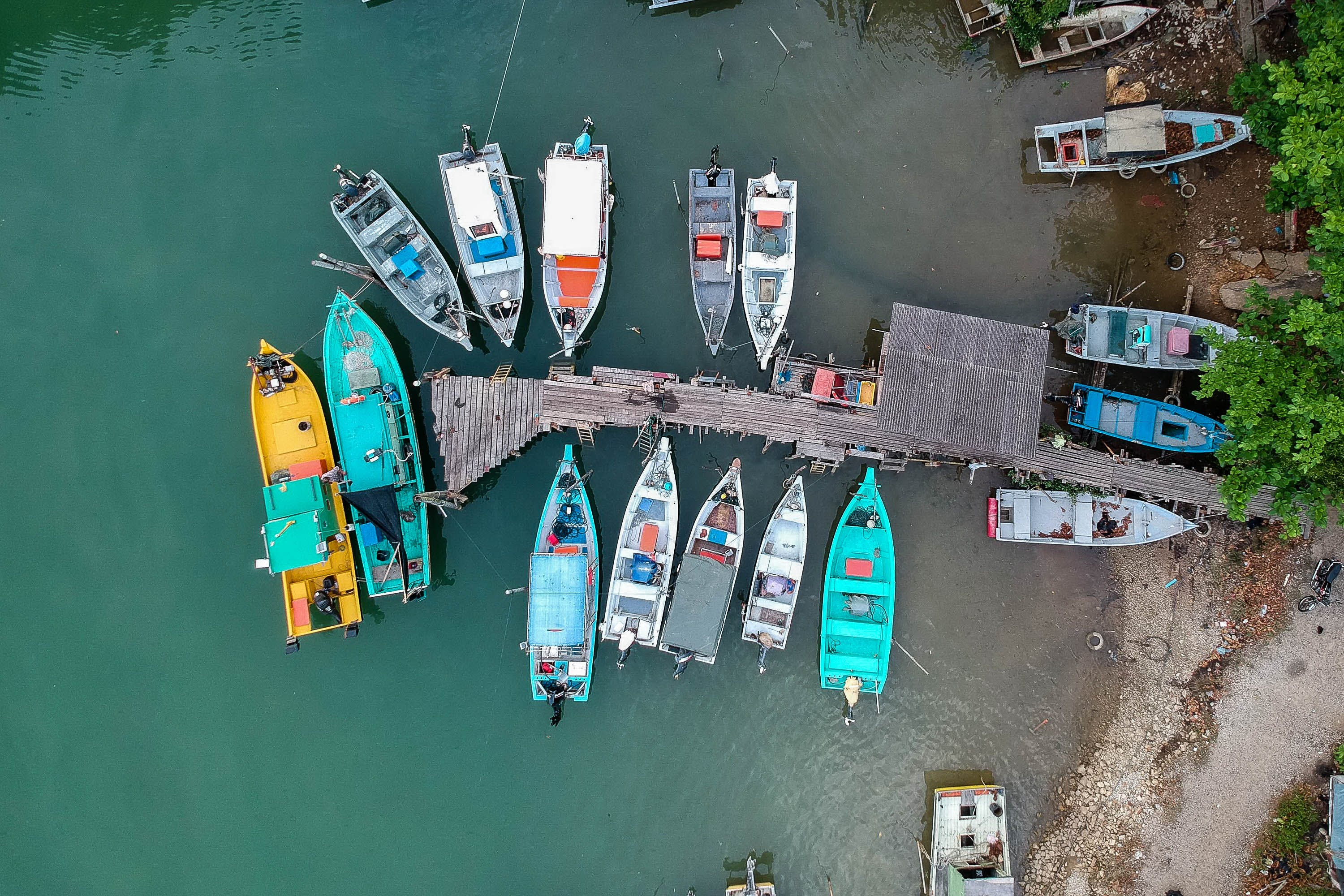 Aerial Shot Of Boats On Body Of Water