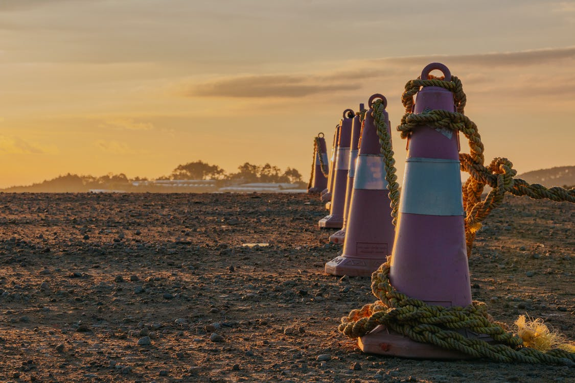 Photo of Traffic Cones with Ropes During Dusk