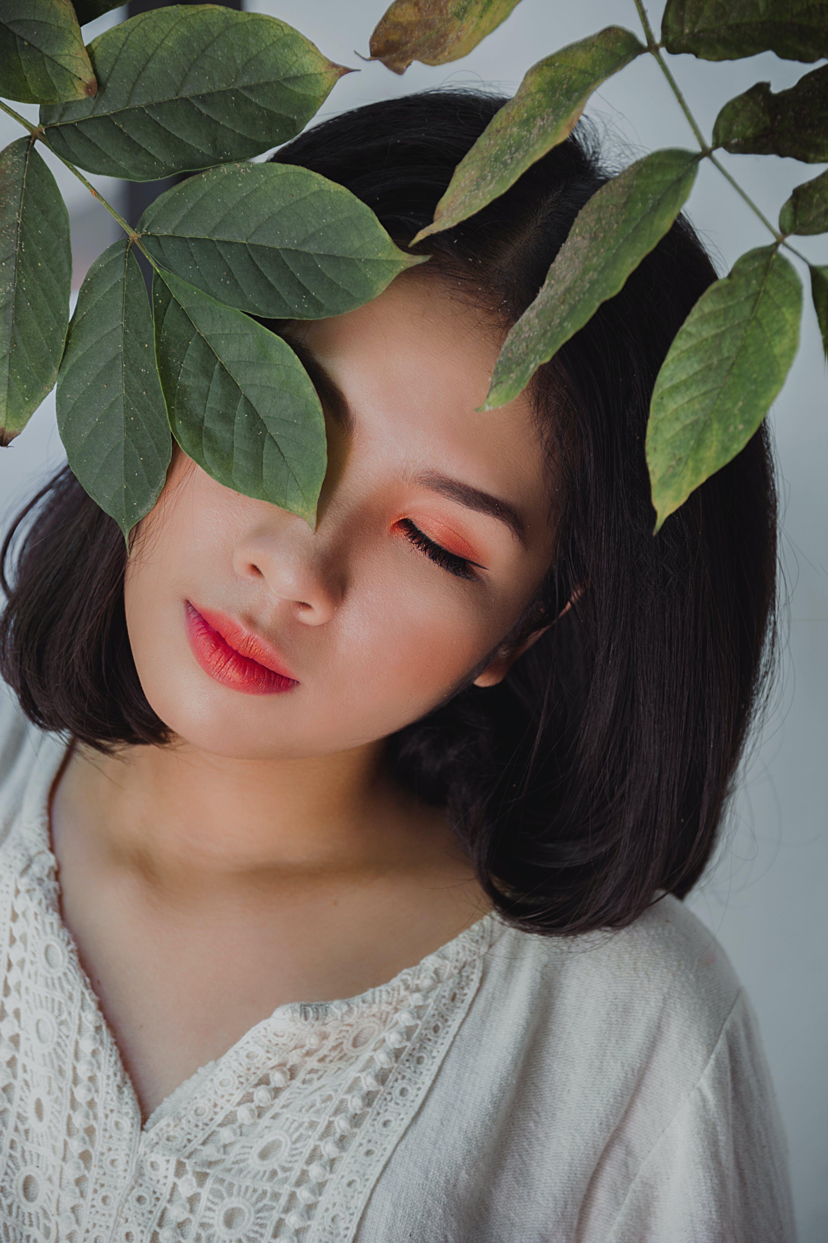 Woman Wearing Beige V-neck Shirt Under Tree