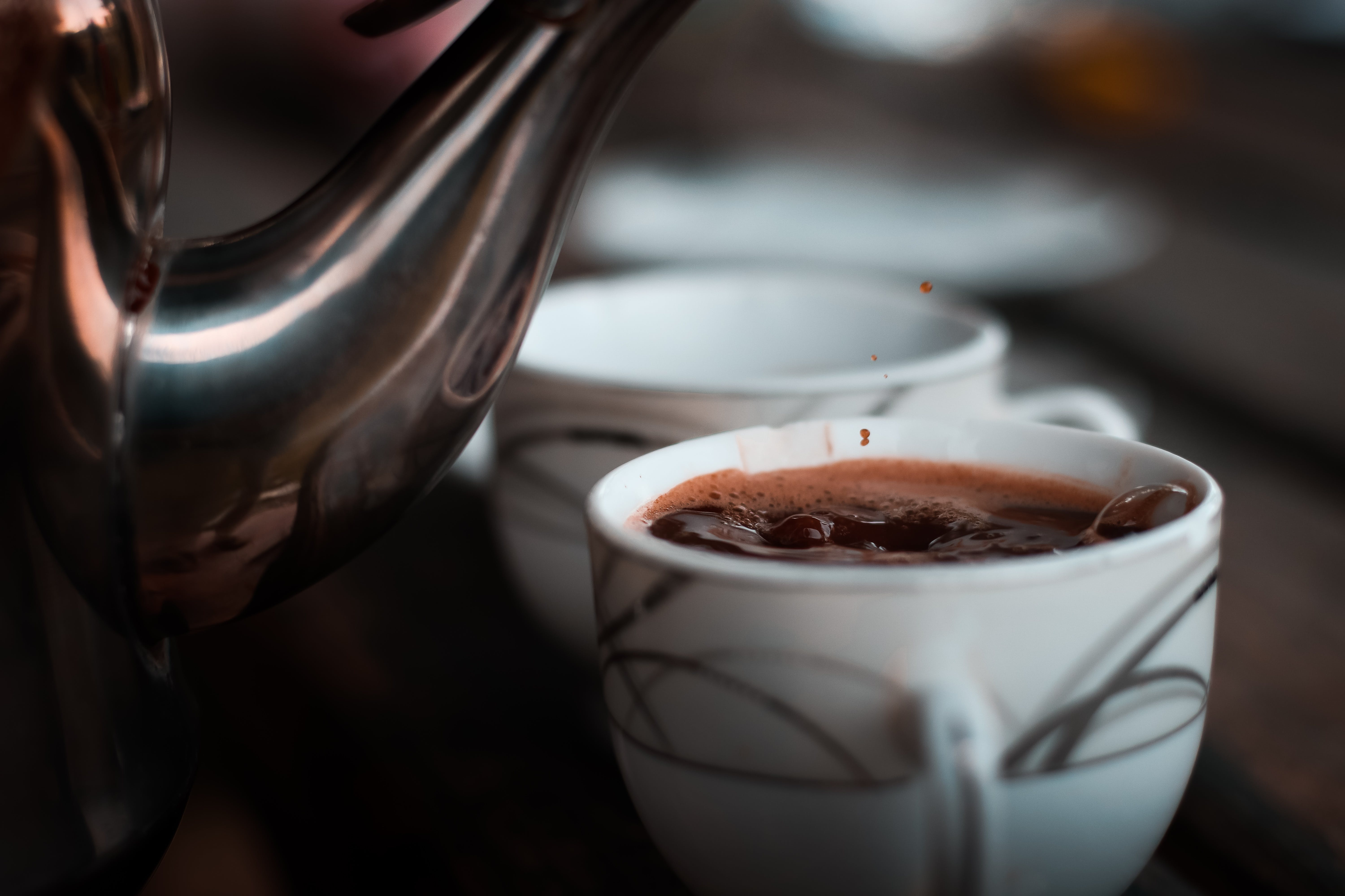 Selective Focus Photography of Teacup With Coffee