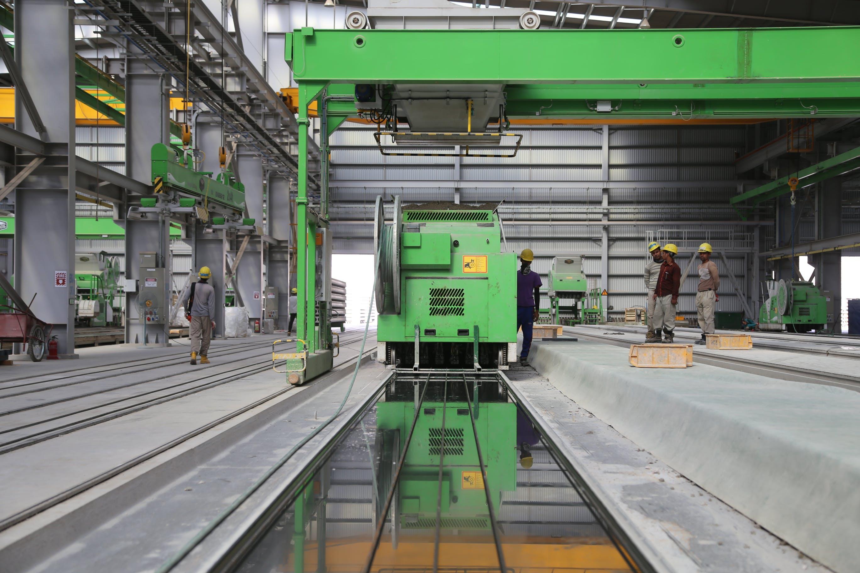 People Stands Near Green Metal Industrial Machine