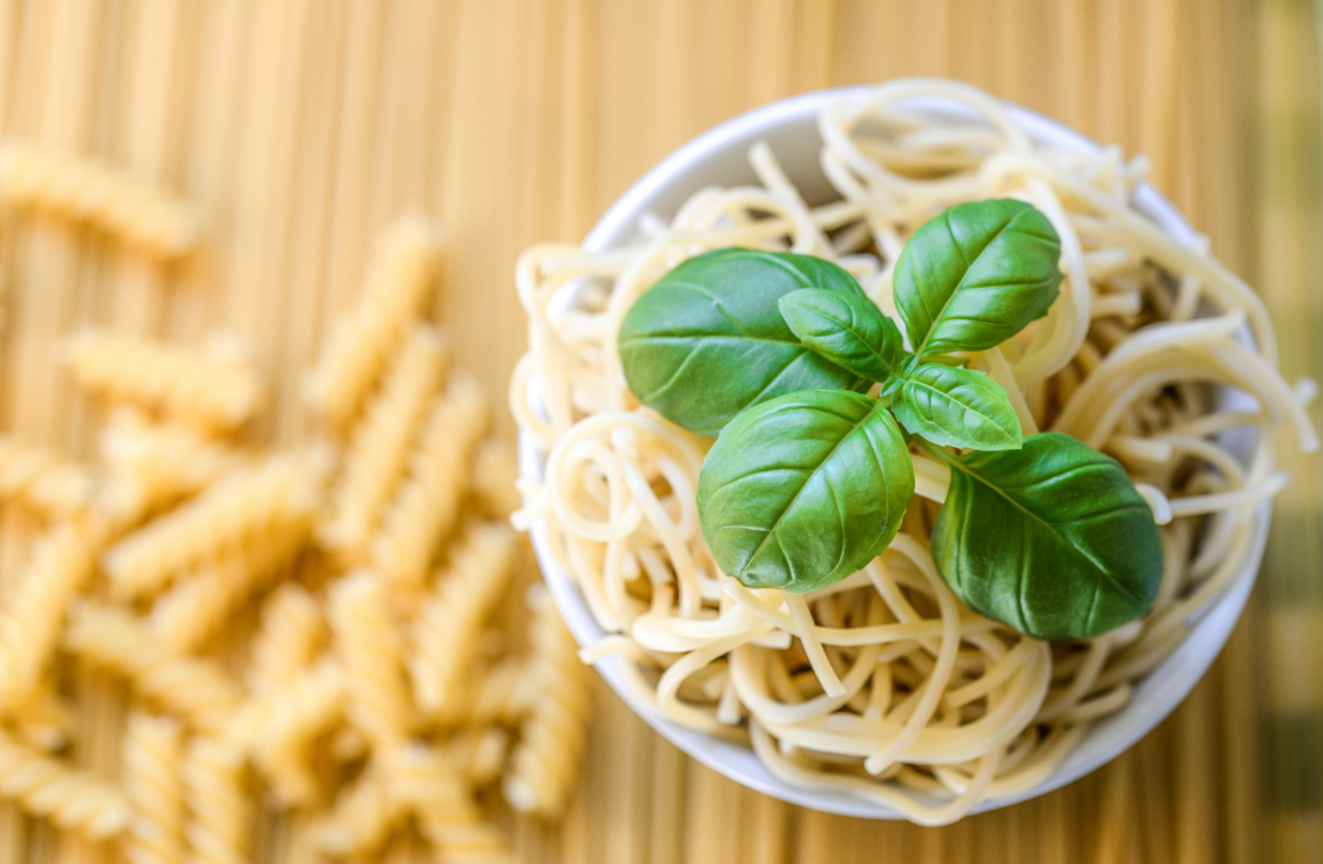 Pasta Noodles With Fresh Basil Leaves