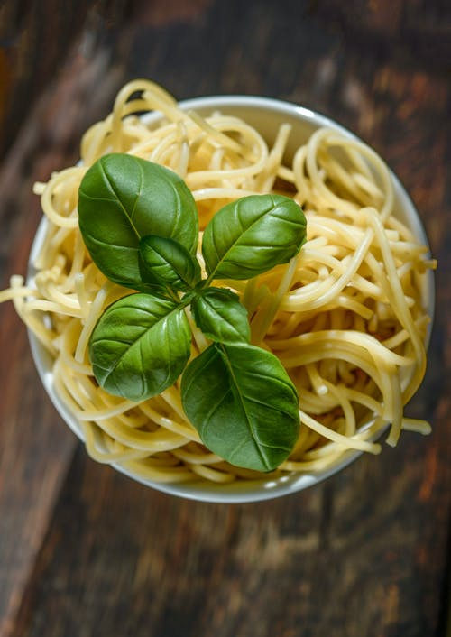 Green Leafed Plant on Pasta