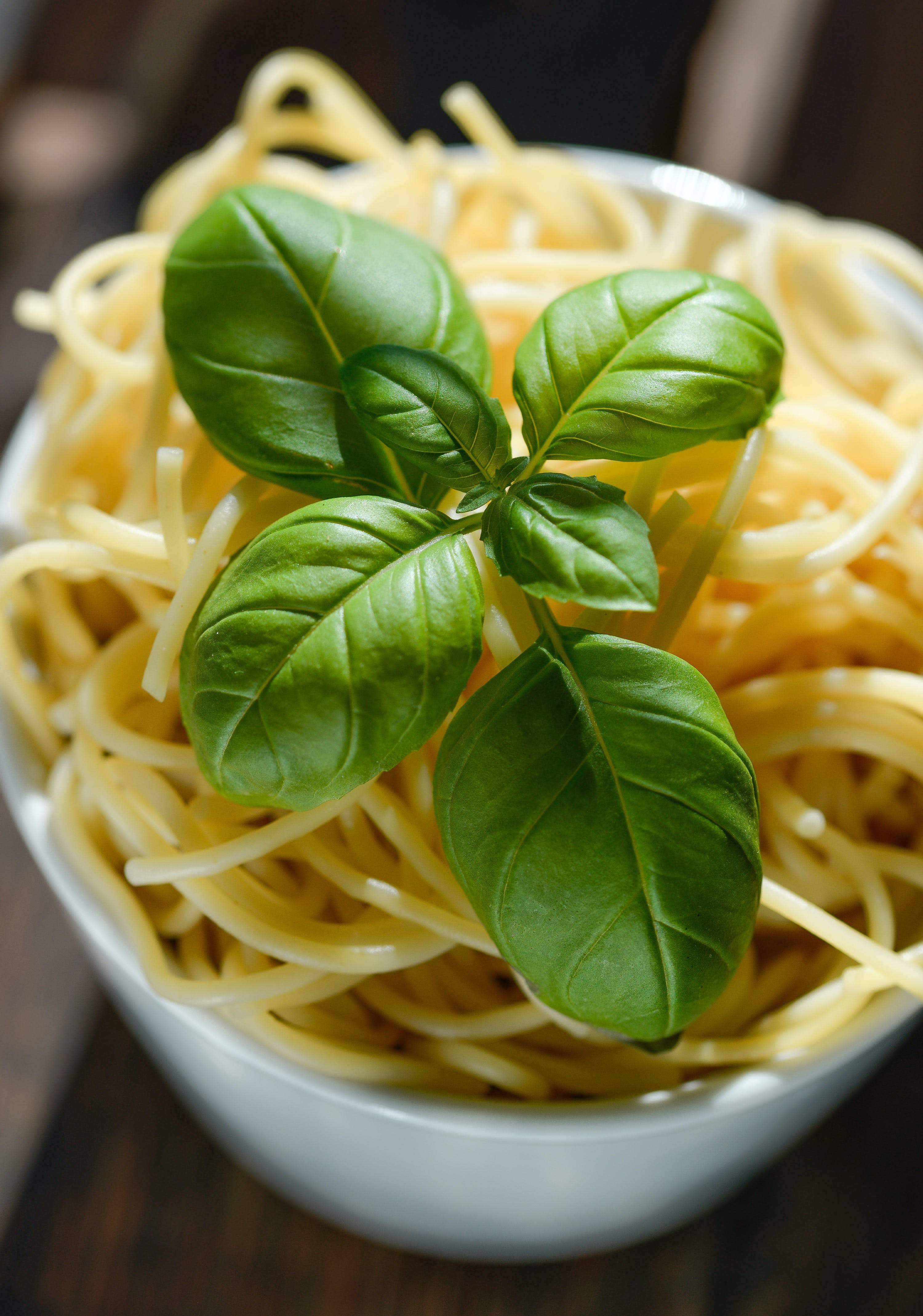 Green Basil Leaves on Top of Pasta