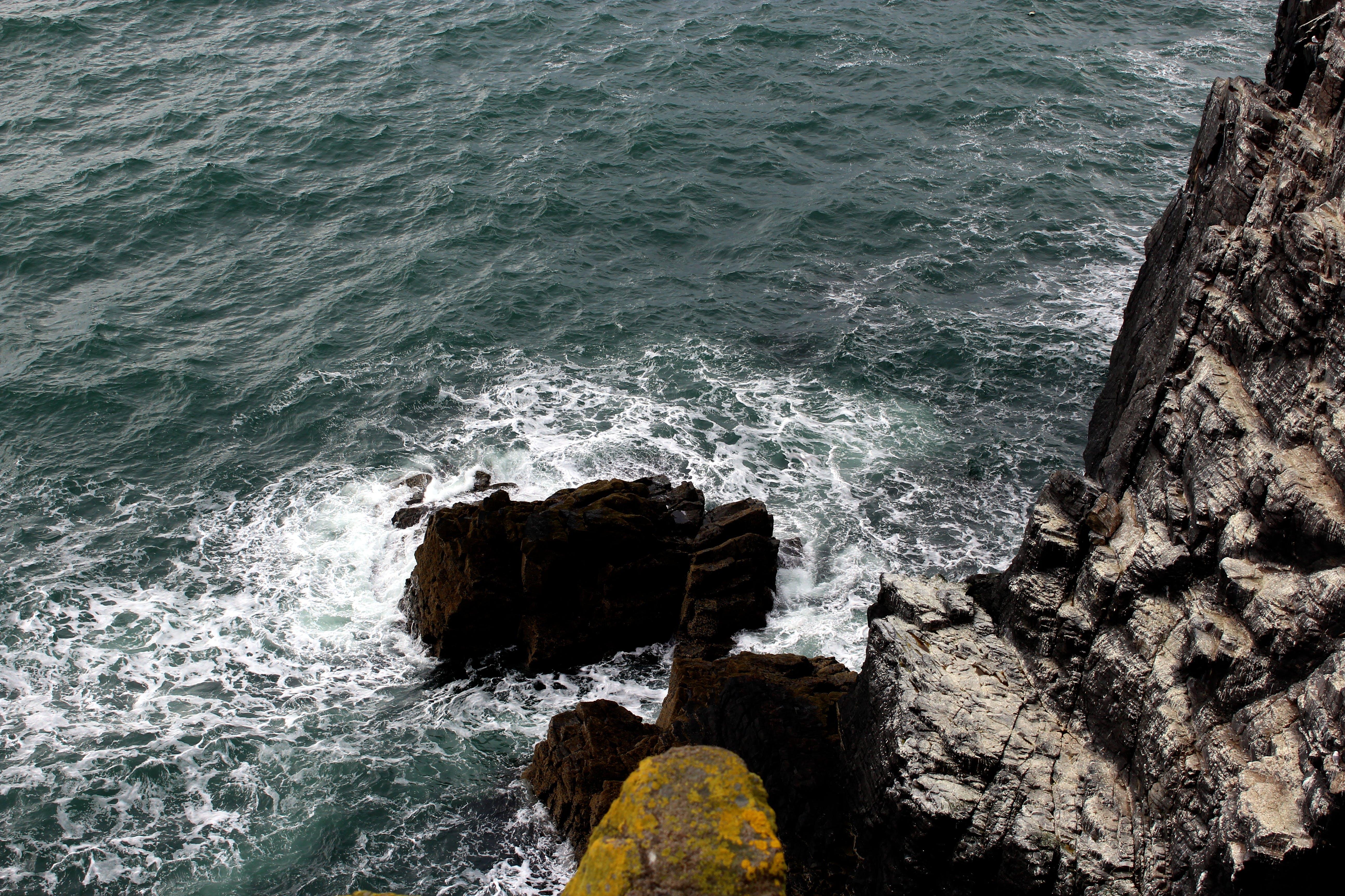 Rock Mountain Beside Body of Water